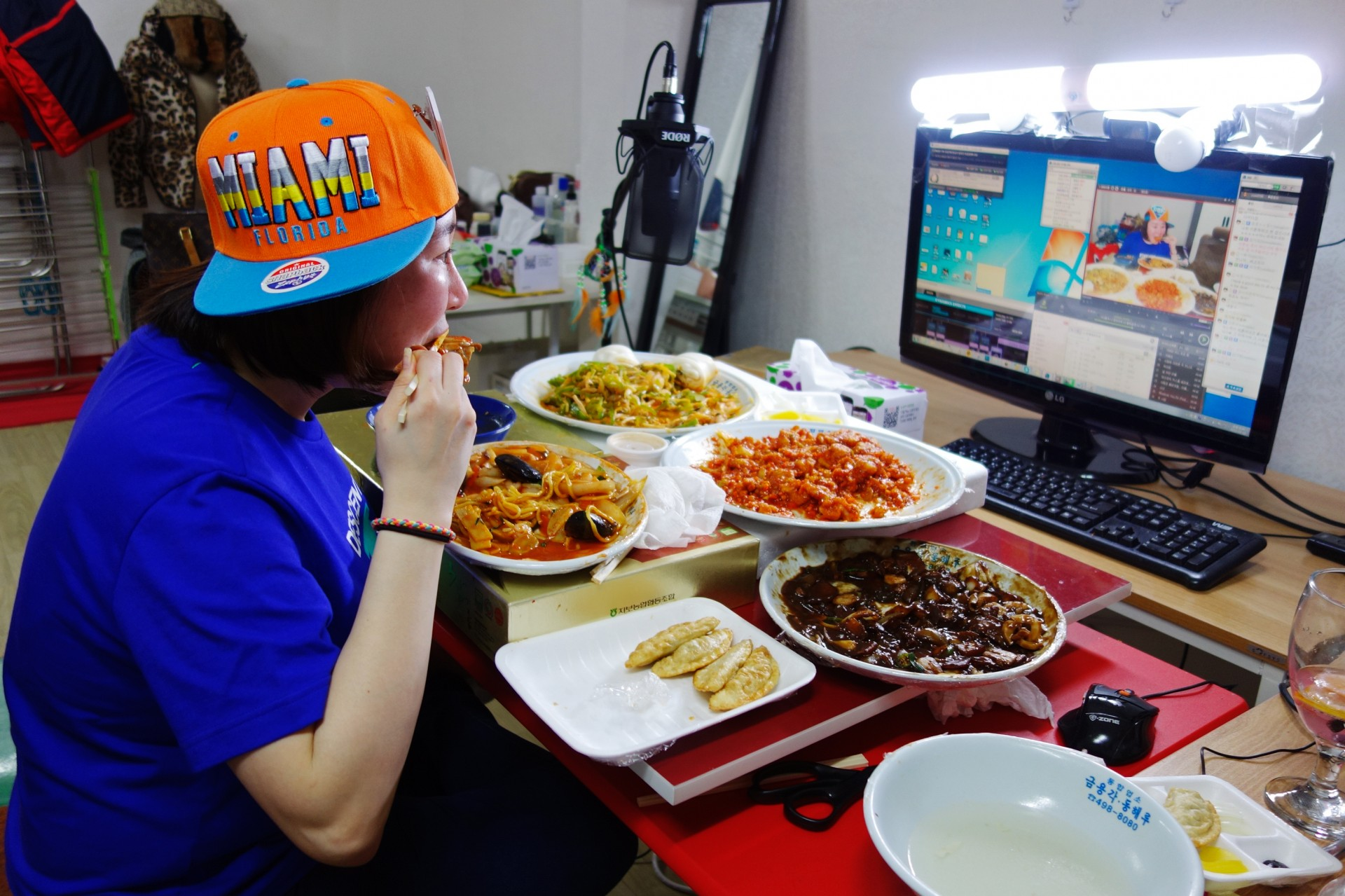 "Rachel Ahn, who goes by ""Aebong-ee,"" is among the top 100 most-watched mukbang stars in South Korea. Photo: Elise Hu/NPR"