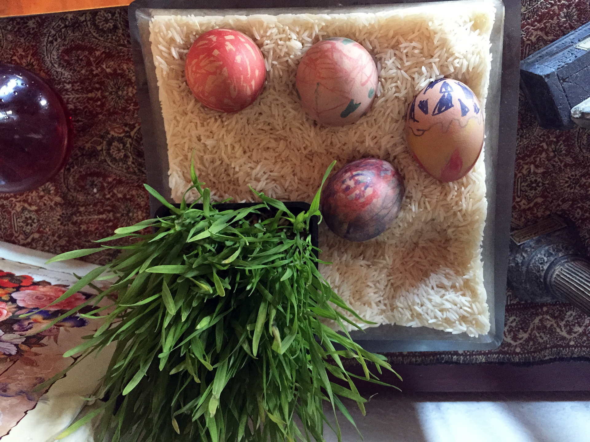 Eggs, which weren't a part of the original haftsin table, symbolize symbolize fertility.