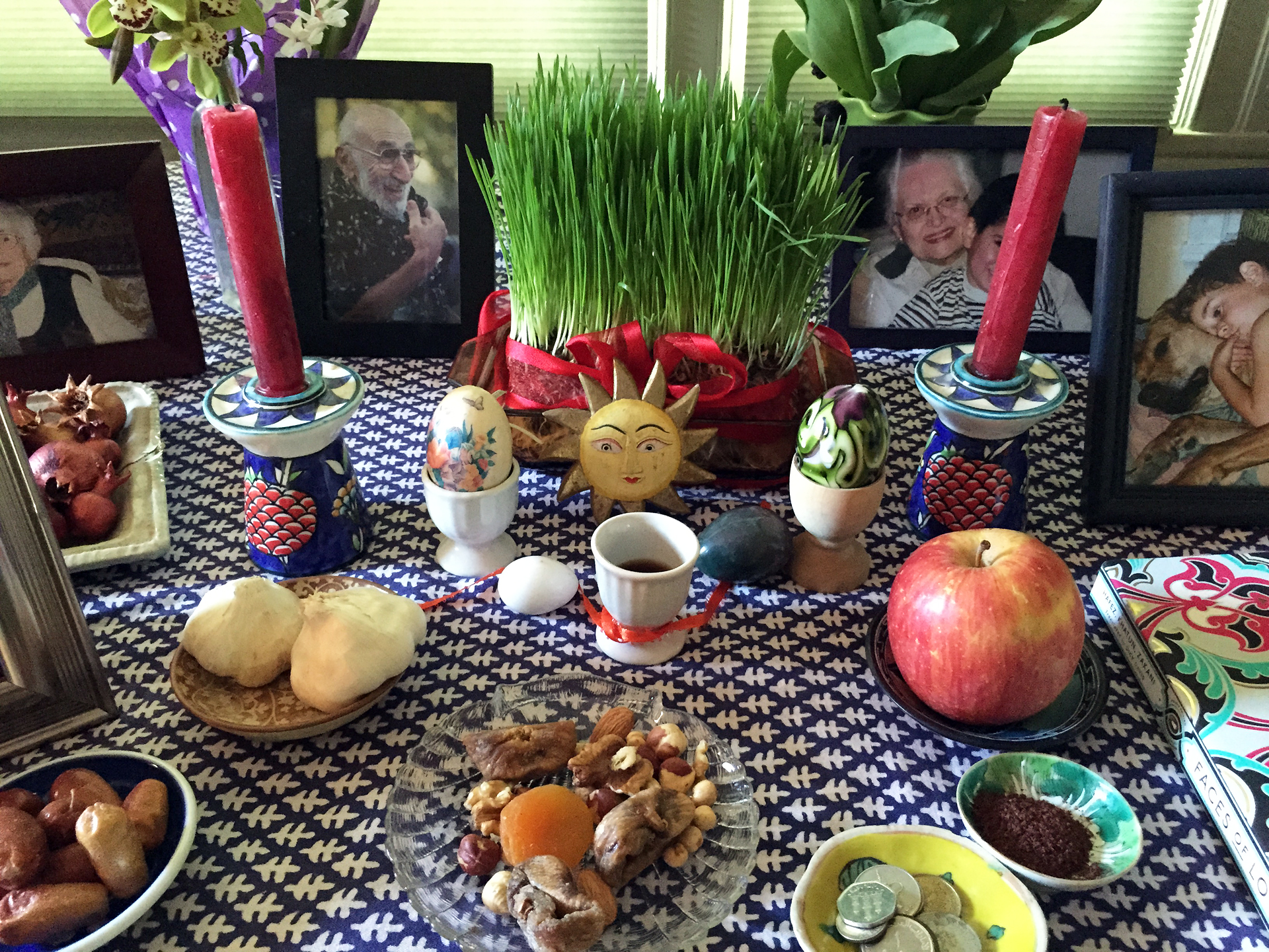 The Persian New Year begins on the first day of Spring. To celebrate, families create a 'haftsin,' a table decorated elaborately with different foods like fresh apples and sprouted herbs.