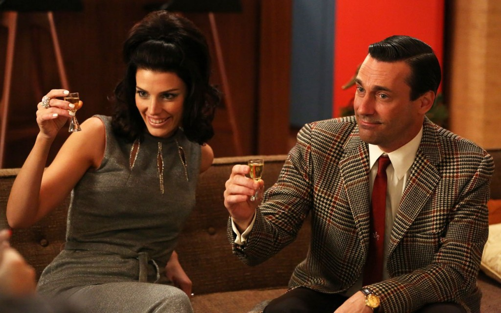 Don and Megan Draper (Jon Hamm and Jessica Paré) raise a glass