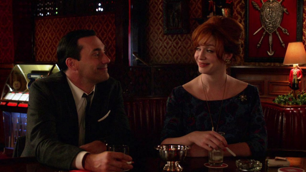 Don (Jon Hamm) drinking whiskeys with Joan Harris (Christina Hendricks.) Photo: AMC