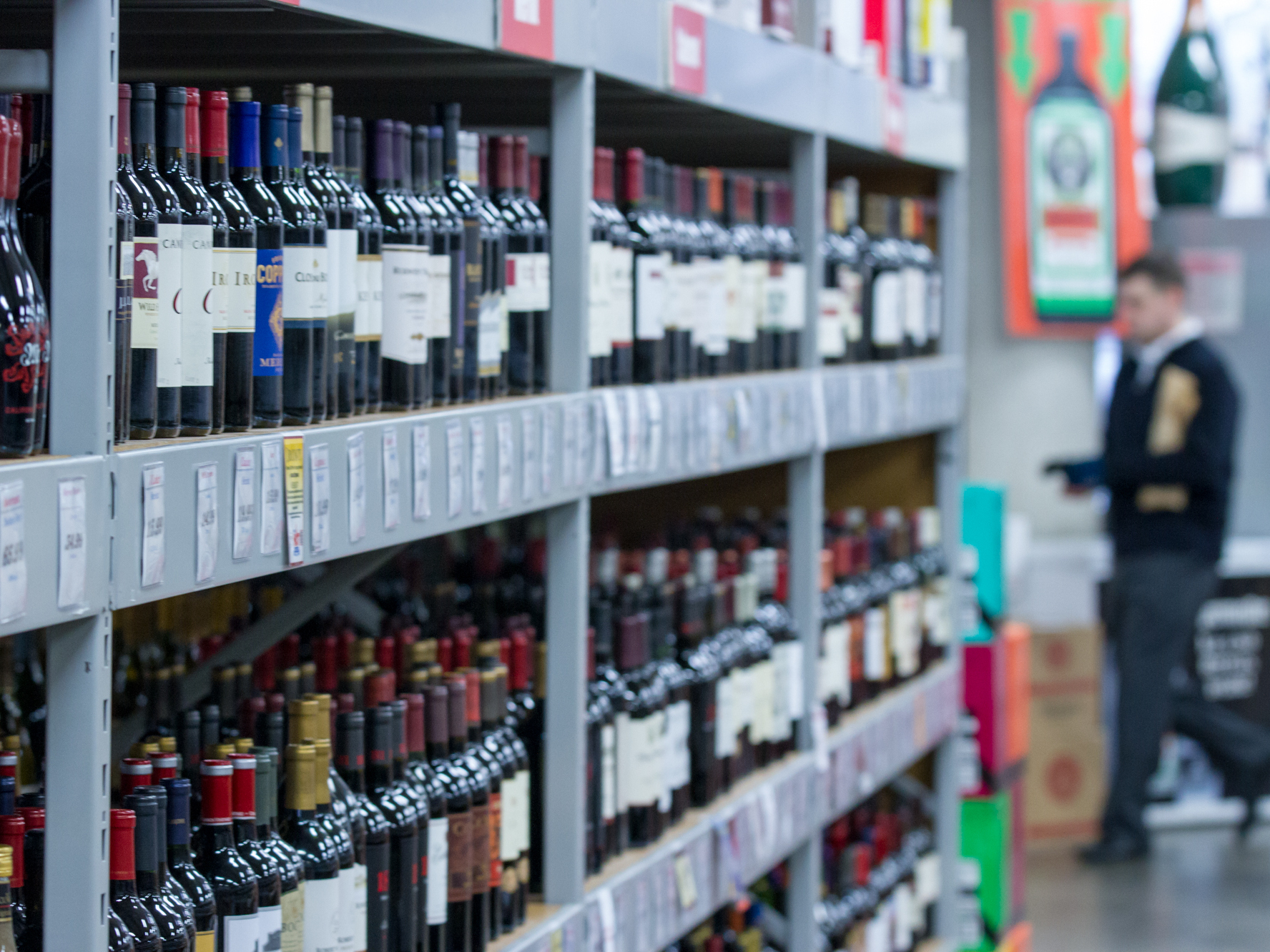 A customer walks by bottles of wine for sale at J. Barleycorn's Liquor Barn in Nashville, Tenn., in 2012. Photo: Erik Schelzig/ASSOCIATED PRESS