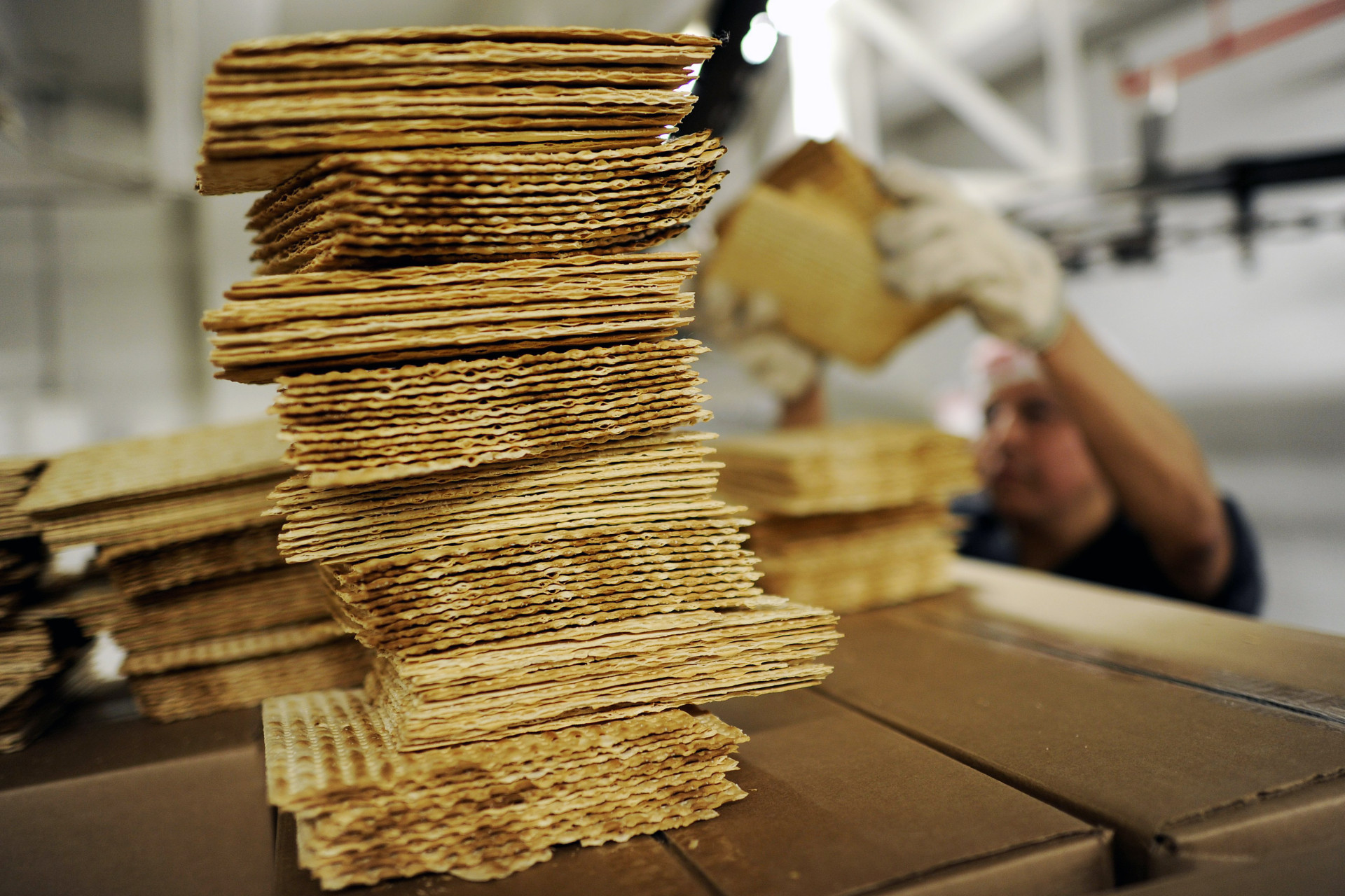 A worker stacks matzo wafers at Streit's matzo factory on the Lower East Side of New York, May 2012.