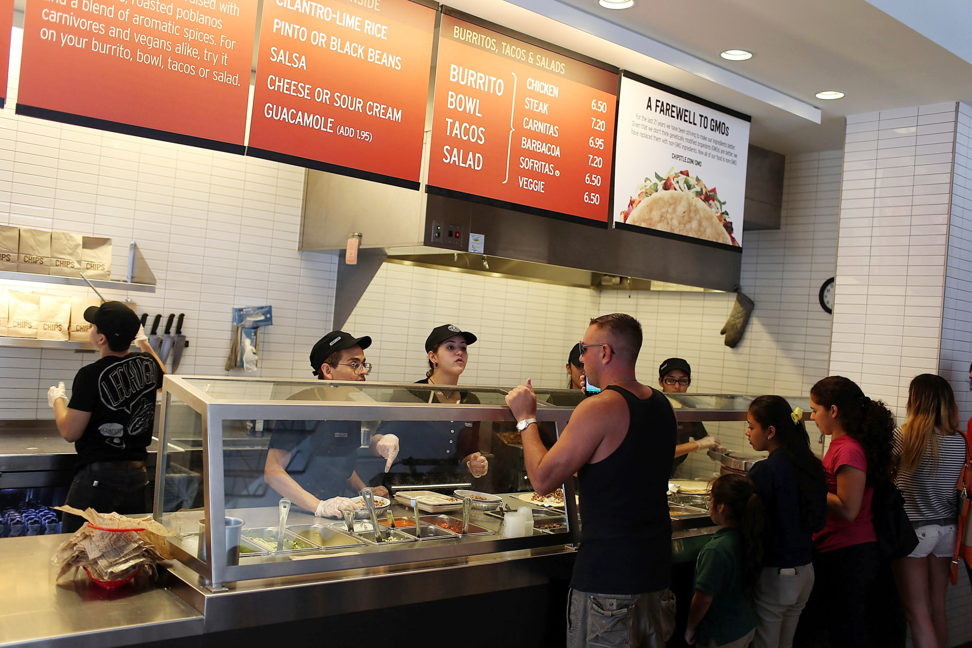 Chipotle restaurant workers in Miami, Fla., fill orders on Apr. 27, the day that the company claimed it would only use non-GMO ingredients in its food.