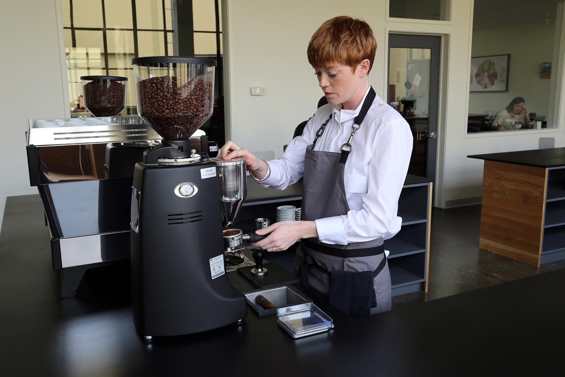 Georgia Cronin, the customer relations person, pulling an espresso.