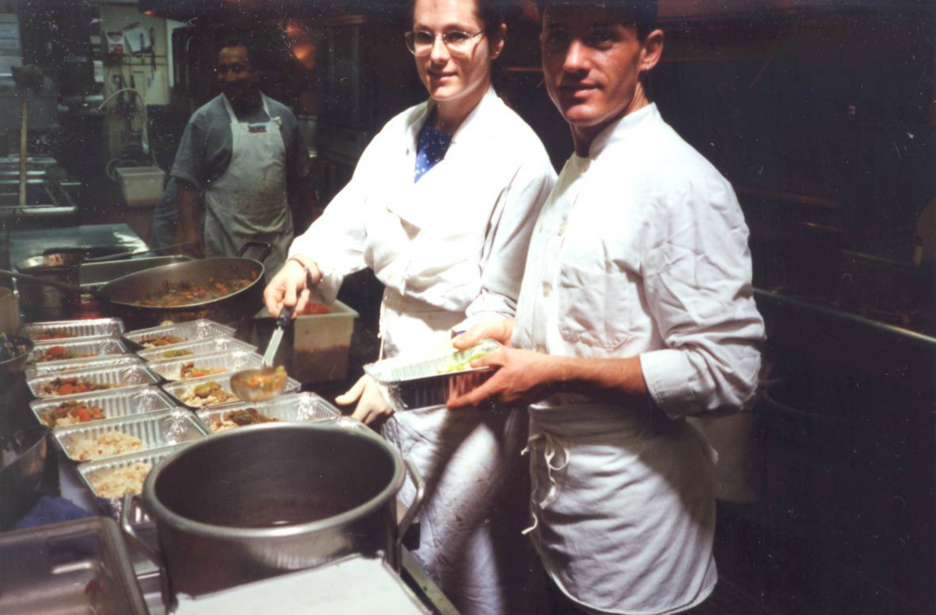 Volunteers prep meals in the organization's early days.
