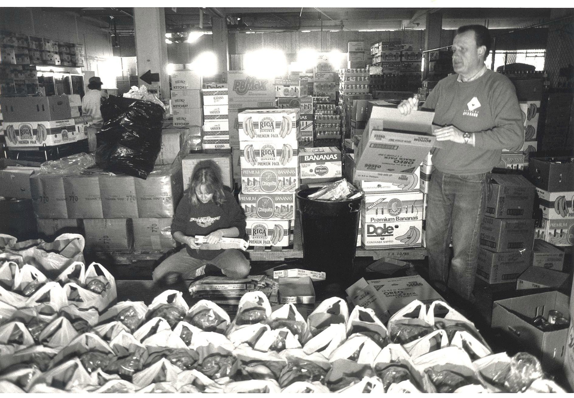 Volunteers bag groceries in the early days.