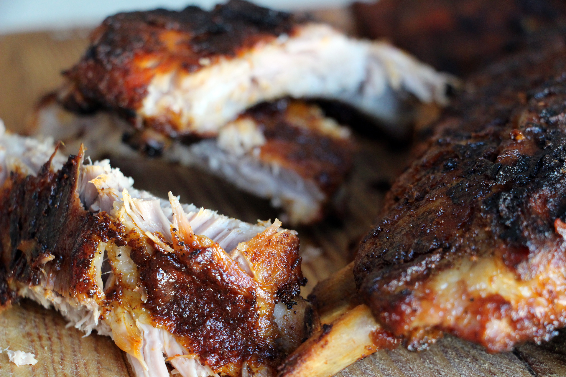 Transfer the ribs to a cutting board and cut between the bones. Serve right away.