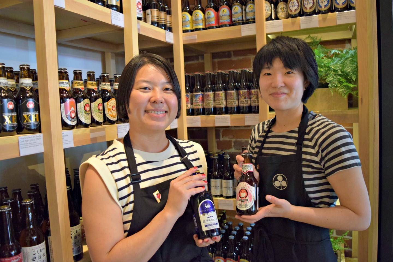 Umami Mart owners Kayoko Akabori (left) and Yoko Kumano (right) with some of their new beers.