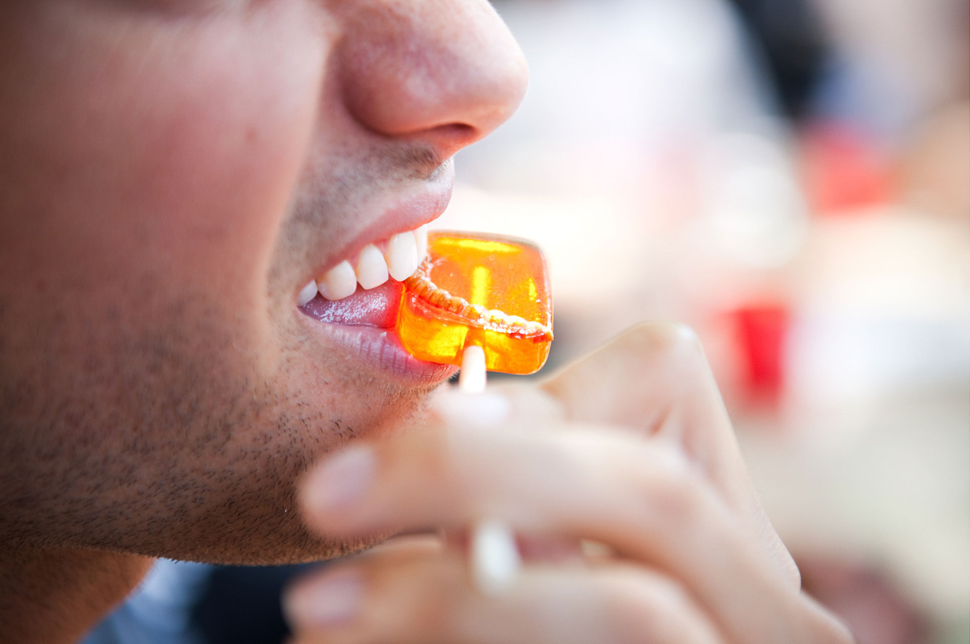 Matt Schnarr bites into a mealworm lollipop at the Pestaurant event in Washington, D.C., in 2014.