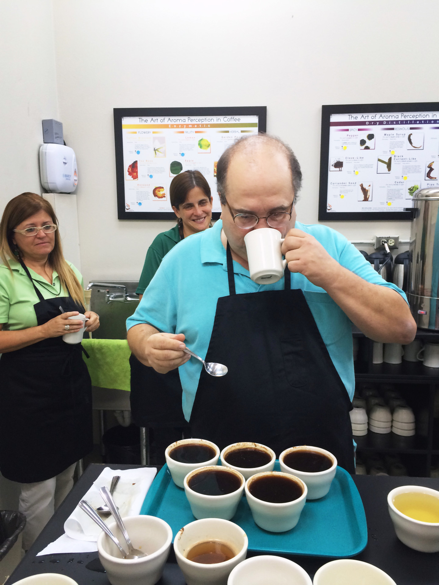 Alfredo Rodriguez, a Puerto Rican coffee farmer and certified taster, teaches a class on the art of cupping — how to taste and discern the quality of coffee.