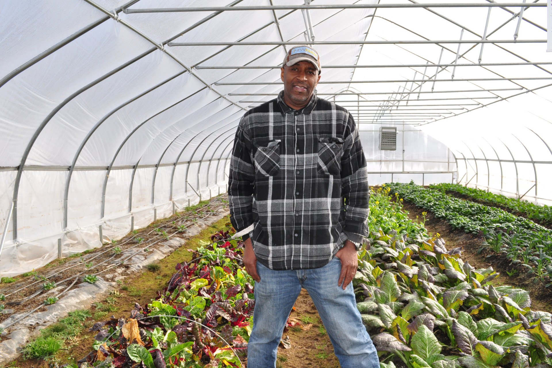 "Mchezaji ""Che"" Axum stands in a hoop house at the University of the District of Columbia's Muirkirk Research Farm, a resource for urban farmers in the city."