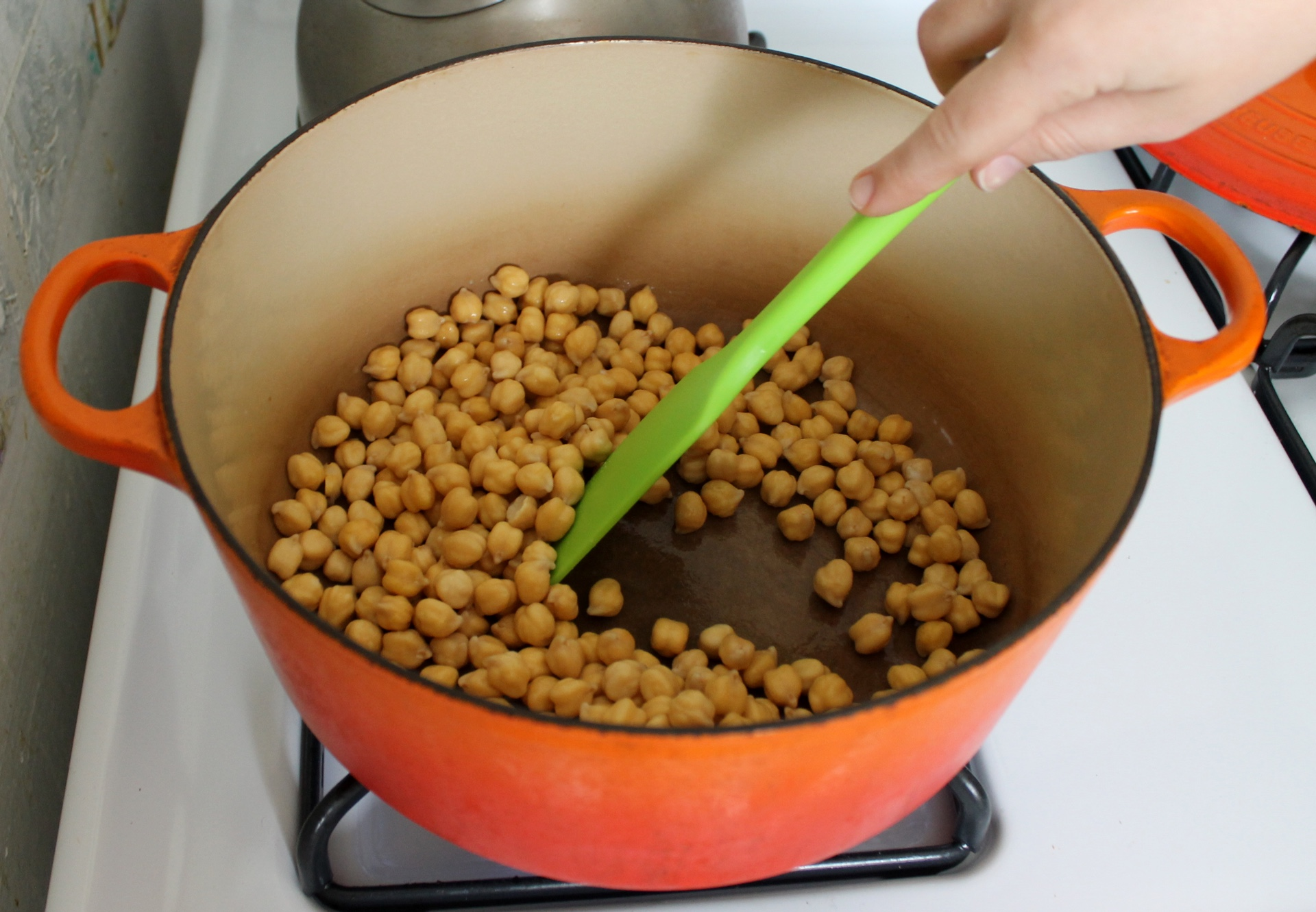 Cooking the chickpeas dry with a little baking soda speeds up cooking and helps remove pesky chickpea skins.