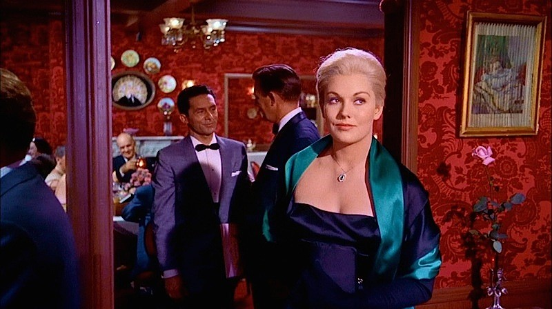 Kim Novak entering Ernie's in a scene from Vertigo