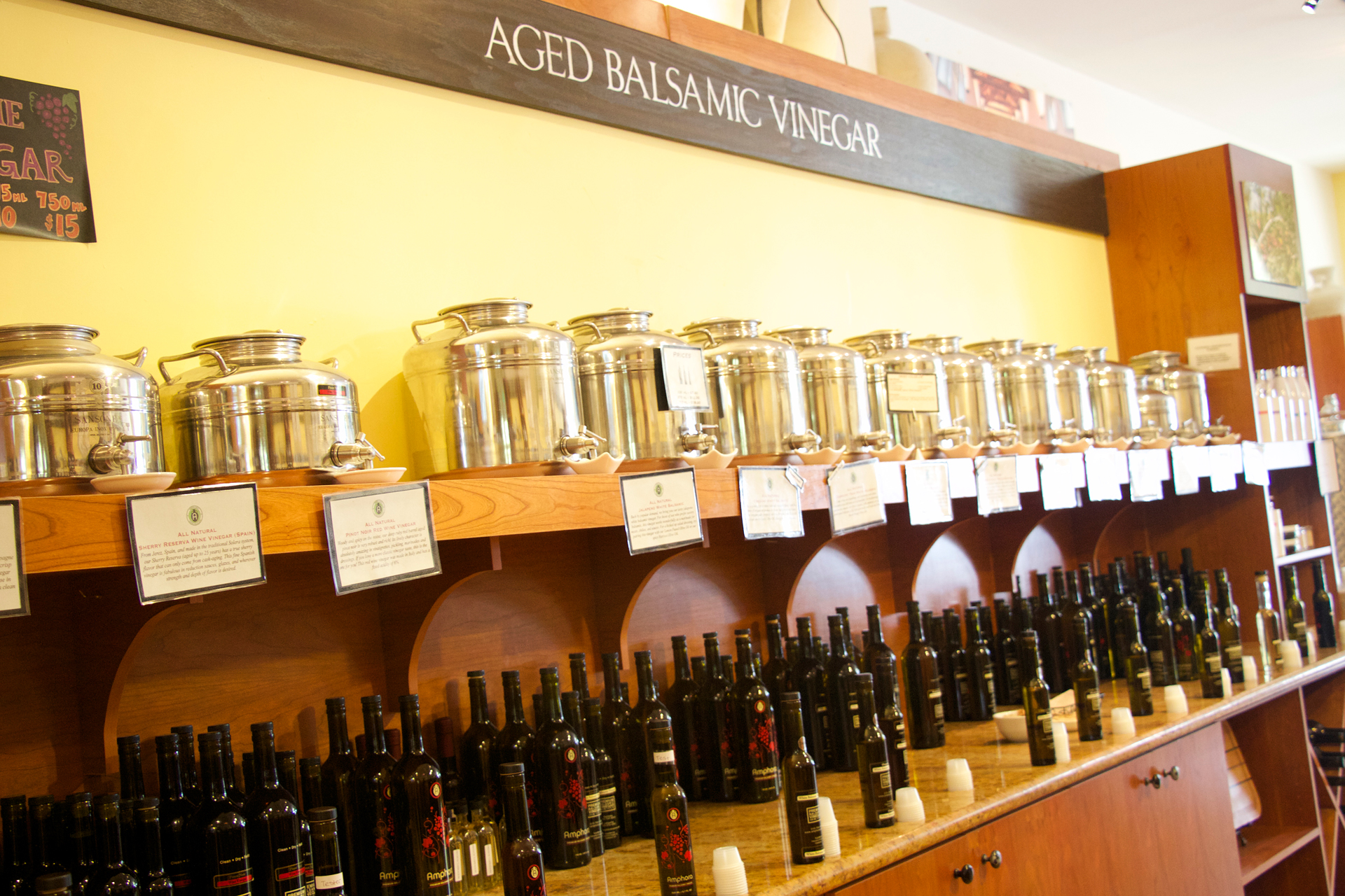 Aged balsamic and flavored vinegars line the shelves at Amphora.