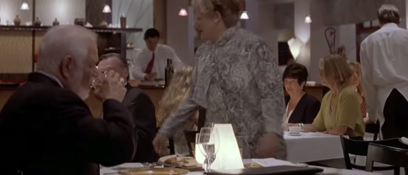 Robin Williams in character as the eponymous Mrs Doubtfire, dining at Bridges in Danville