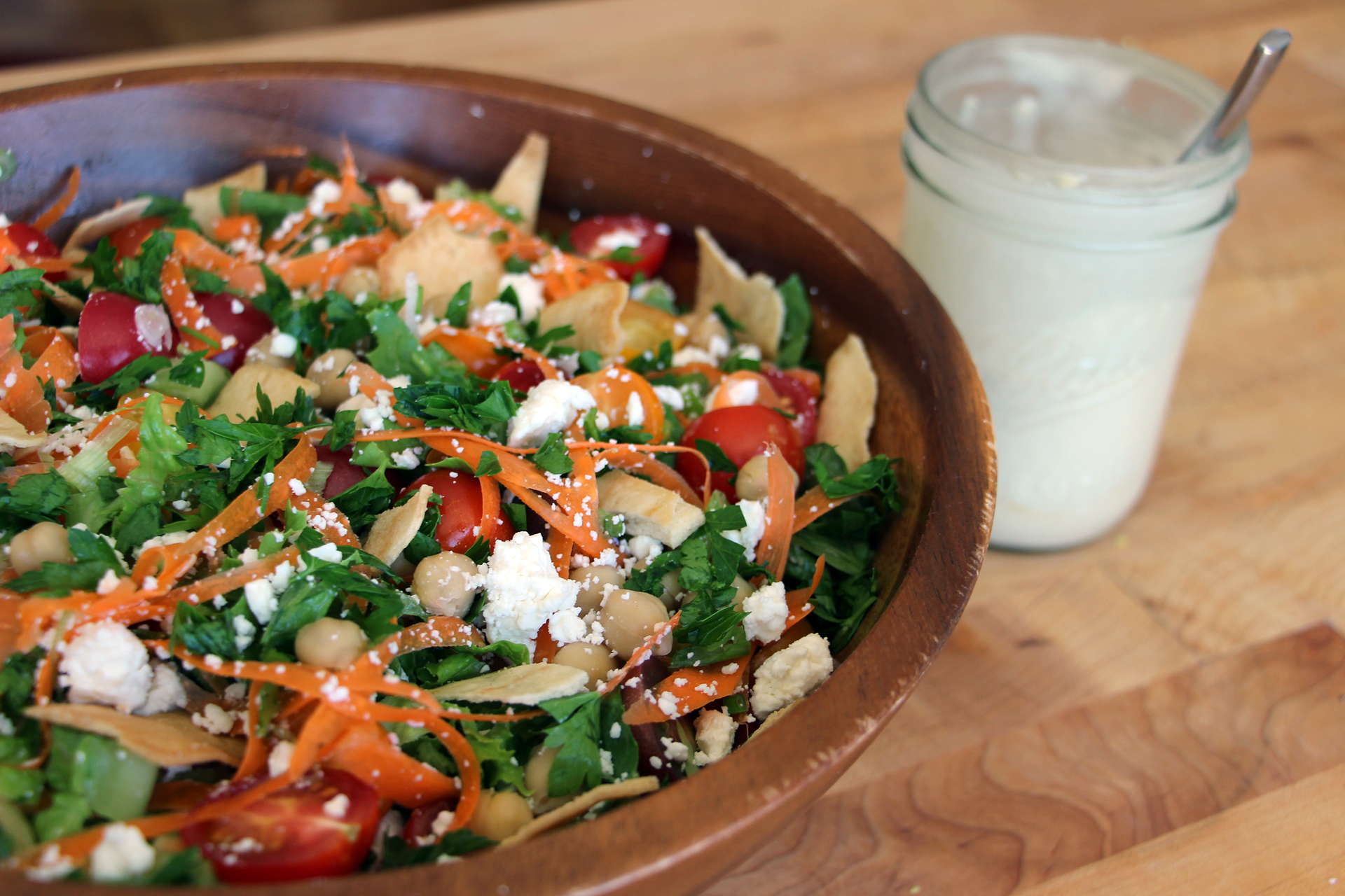 Add pita chips to Mediterranean Salad and serve with extra Tahini dressing on the side..