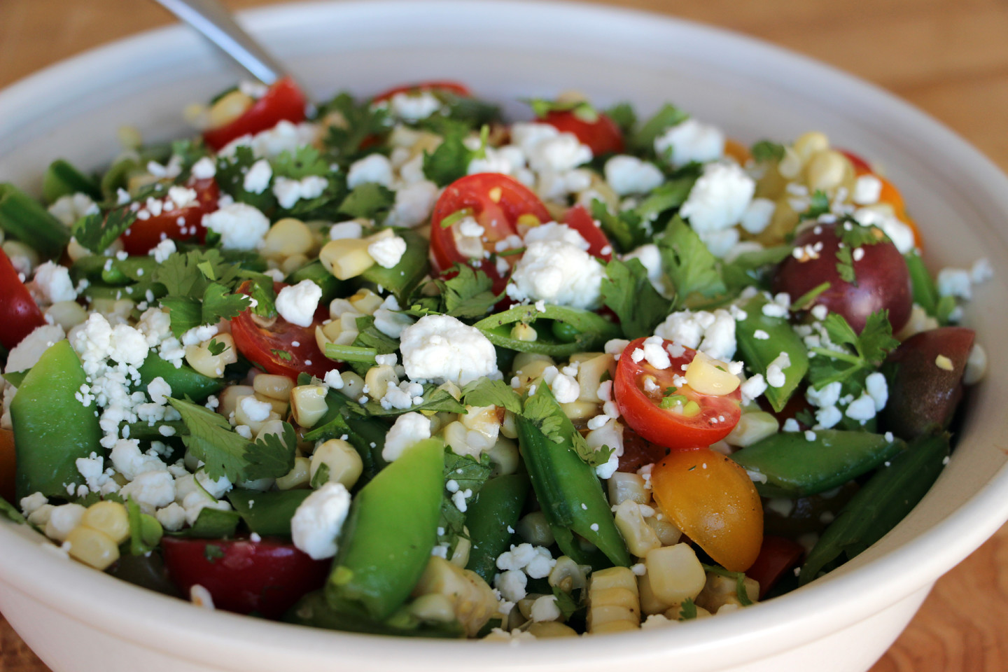 Bring On the Barbecue: Grilled Corn Salad with Sugar Snap Peas, Cherry Tomatoes, and Goat Cheese