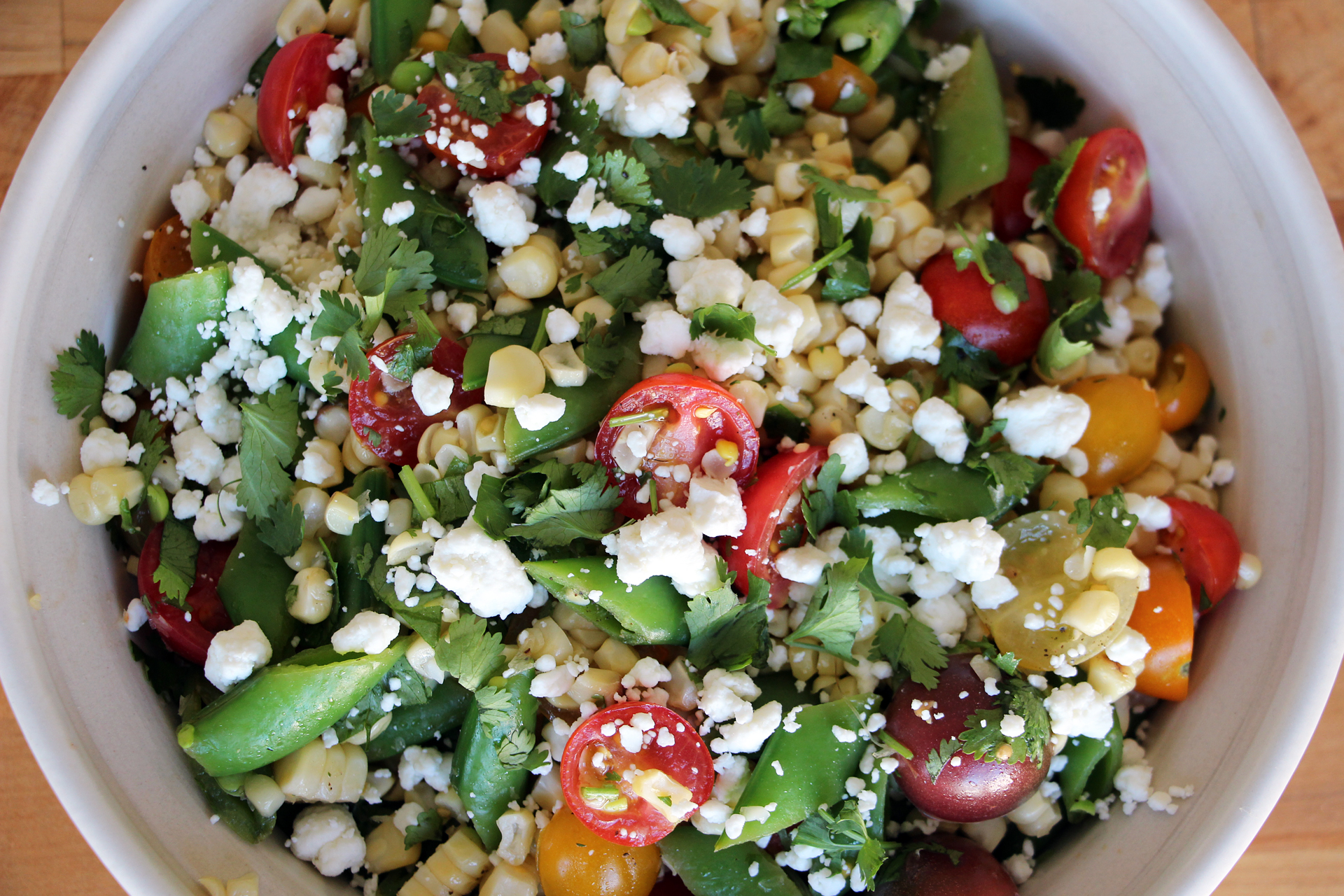 Grilled Corn Salad with Sugar Snaps, Cherry Tomatoes, and Goat Cheese