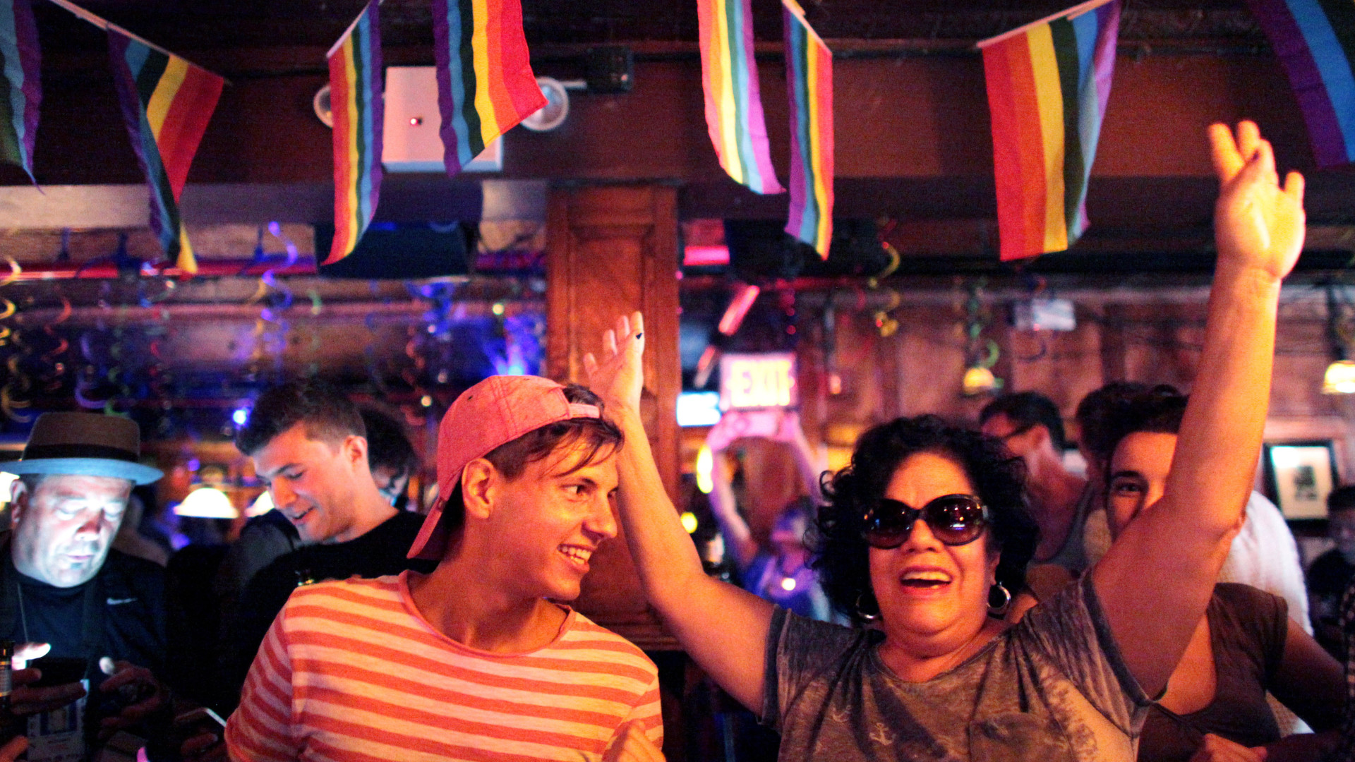 People celebrate inside the Stonewall Inn, an iconic gay bar recently granted historic landmark status, after the U.S. Supreme Court ruled same-sex couples have the right marry in all 50 states.