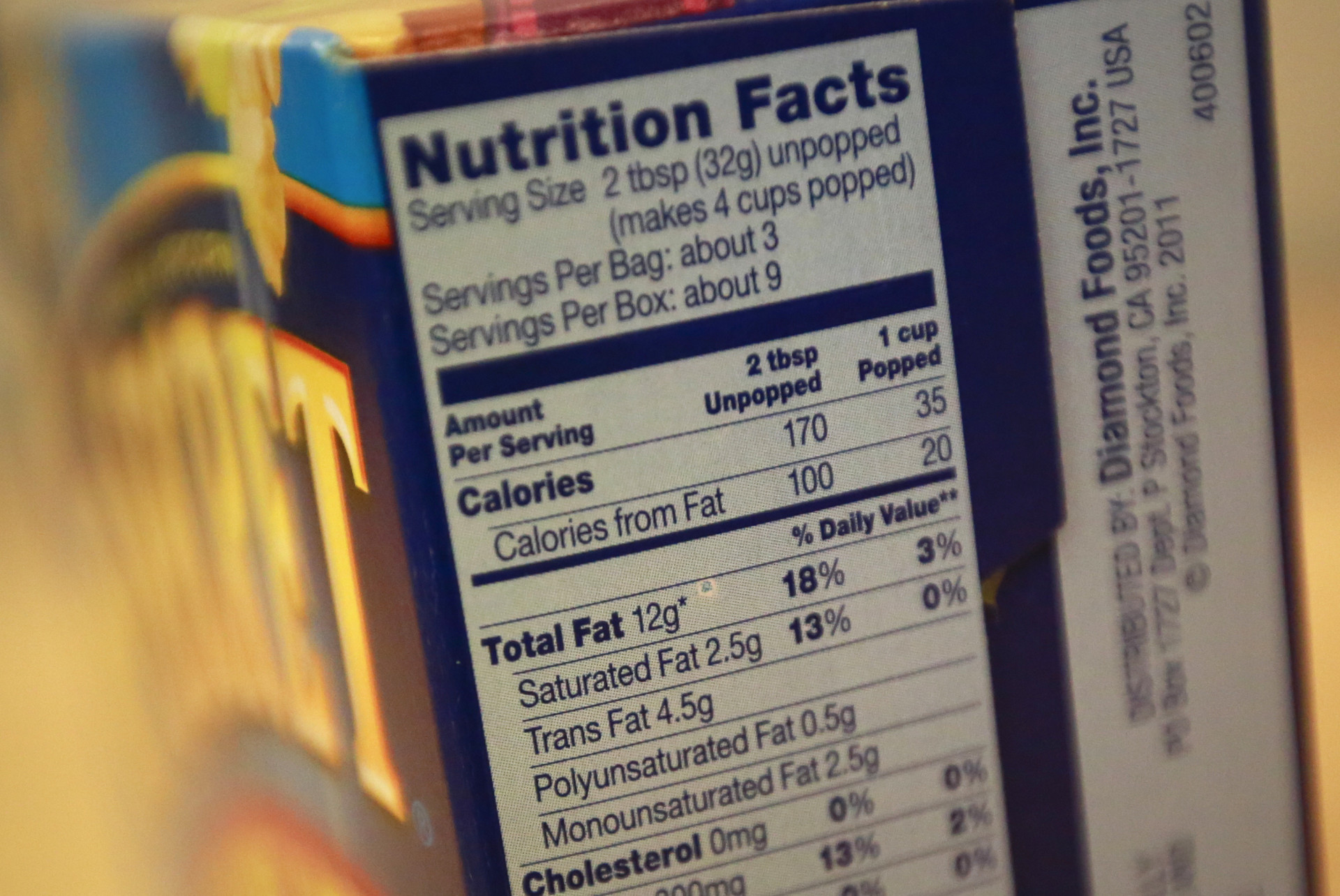 Microwave popcorn containing trans fats from November 2013. The Grocery Manufacturers Association says the industry has lowered the amount of trans fat added to food products by more than 86 percent. But trans fats can still be found in some processed food items.