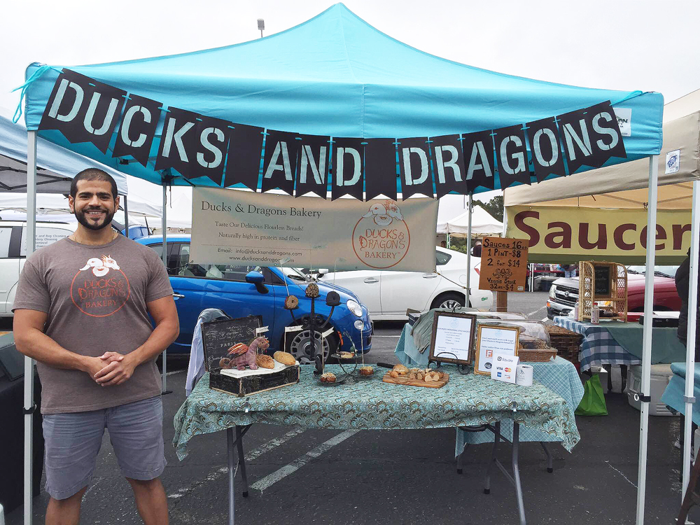 Makram is all smiles at his first farmers market stand, this one at the College of San Mateo.