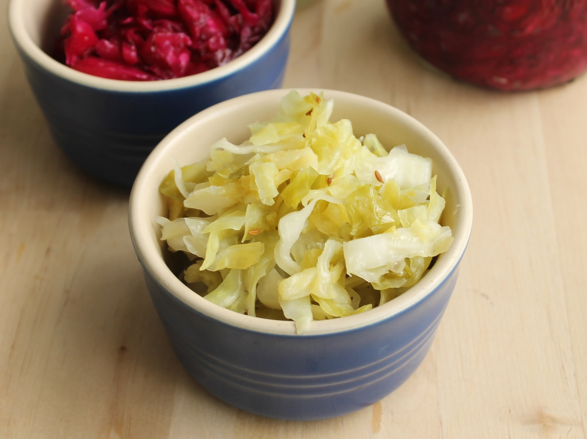 Homemade sauerkraut with caraway (front) and homemade beet and chile sauerkraut (rear).