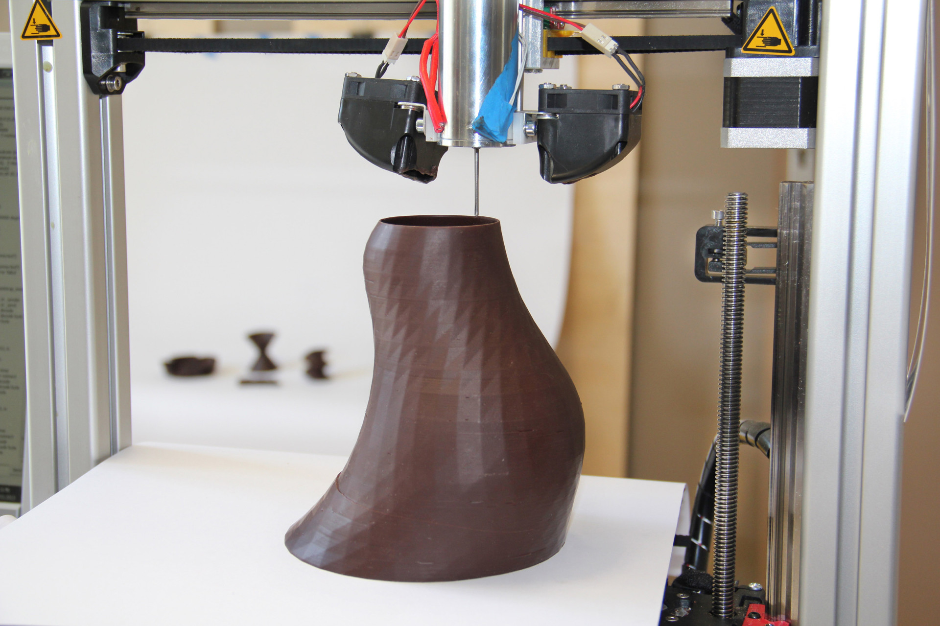 For 3-D food printers, chocolate is a good material to start with, because it's fairly simple to keep it liquid inside the printer cartridge and solid once it drops out.