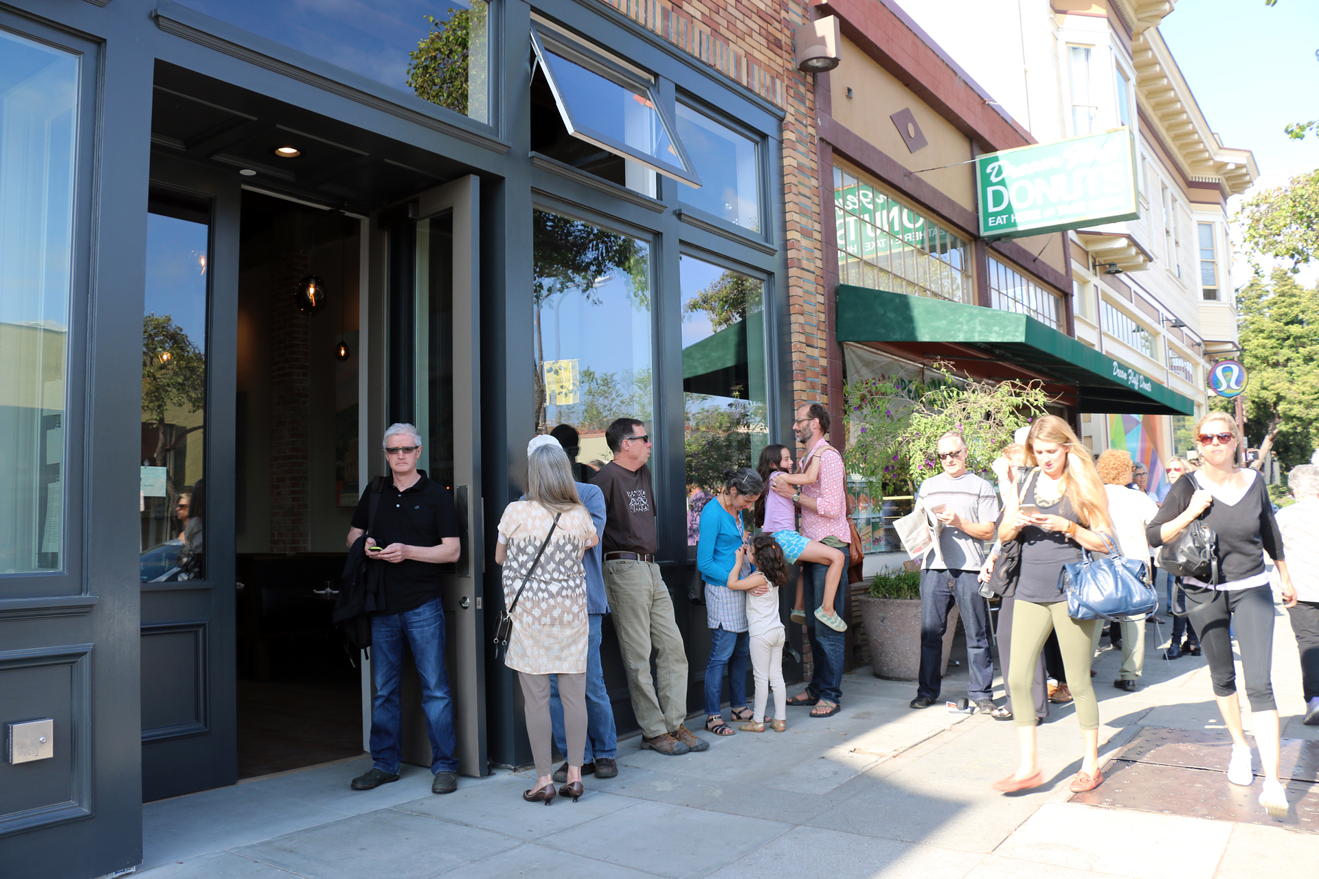 Lining up for the opening of The Advocate in Berkeley's Elmwood neighborhood.