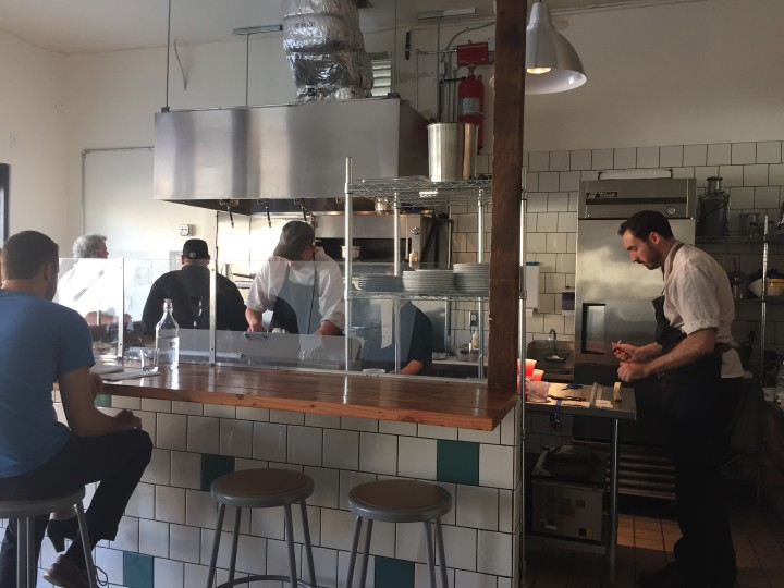 Chef Marcus Krauss (right) works in the open kitchen at Salsipuedes.