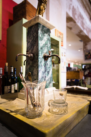 This drip fountain, on display at the Southern Food and Beverage Museum, is a replica of the one found at the Old Absinthe House in New Orleans. Drip fountains were an economical way to cool down water before adding it to absinthe, while also prolonging the spectacle of le louche.