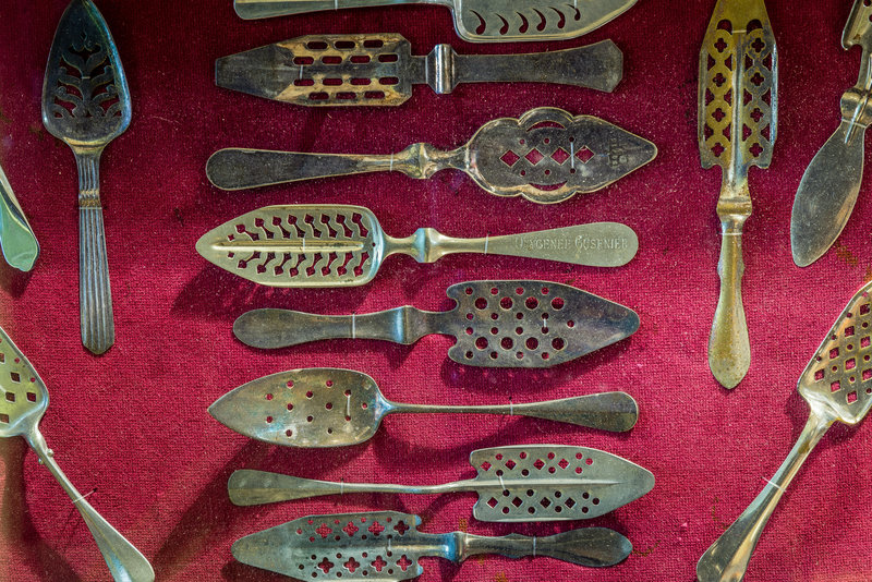 An assortment of slotted absinthe spoons from the late 19th century. They were mostly used in bars and absinthe houses in Europe.