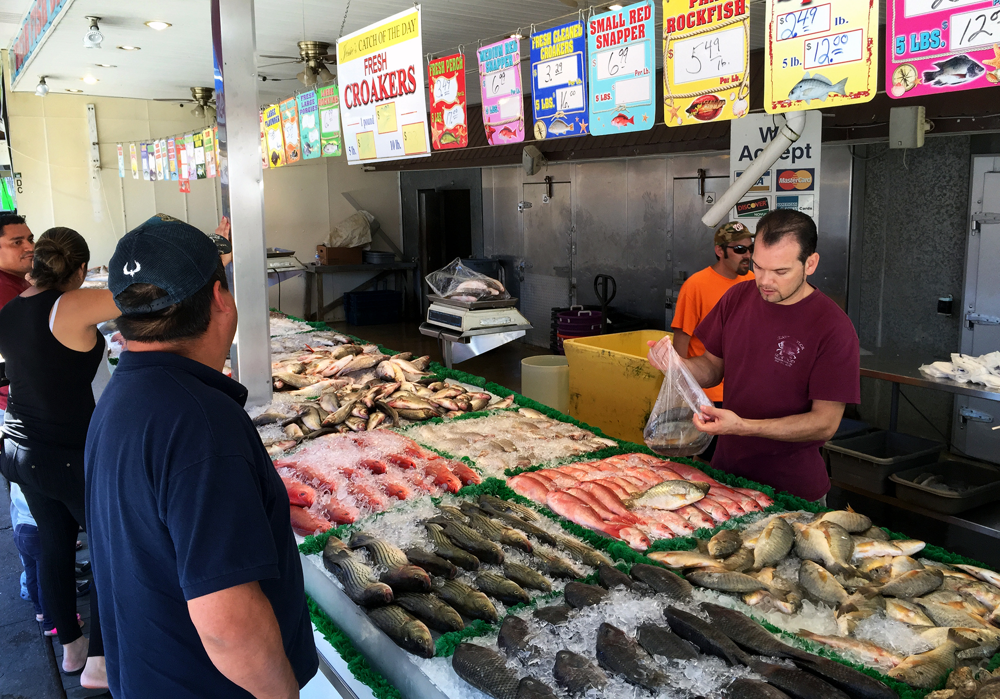 Customers shop for salmon at a fish market in southwest Washington, D.C. Most Americans don't eat the recommended amount of fish each week.
