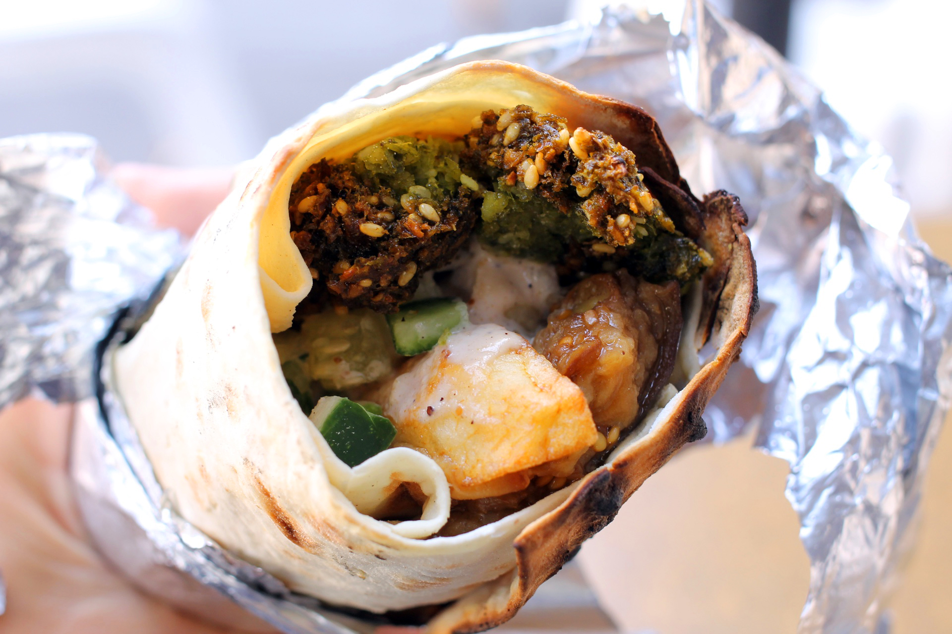 The falafel deluxe sandwich at Truly Mediterranean in San Francisco includes eggplant and potatoes in addition to falafel.