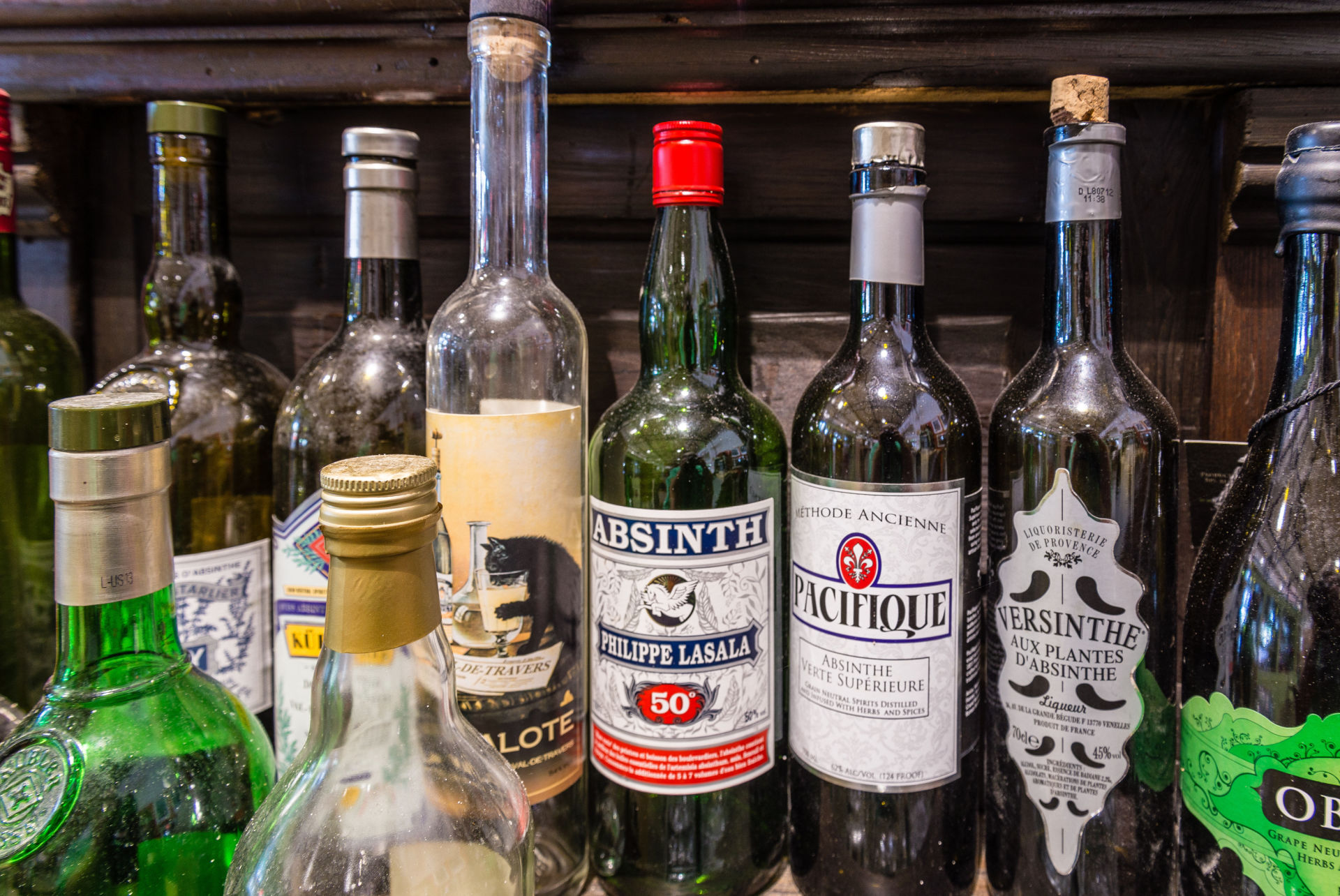 Bottles of absinthe line the bar at a display dedicated to the drink at the Southern Food and Beverage Museum in New Orleans.