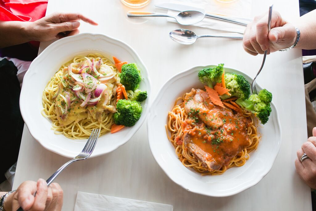 Two of the pasta dishes served as part of the CHAMPSS menu for seniors at Prince Cooking, a Hong Kong-style restaurant in San Francisco's Outer Sunset district.