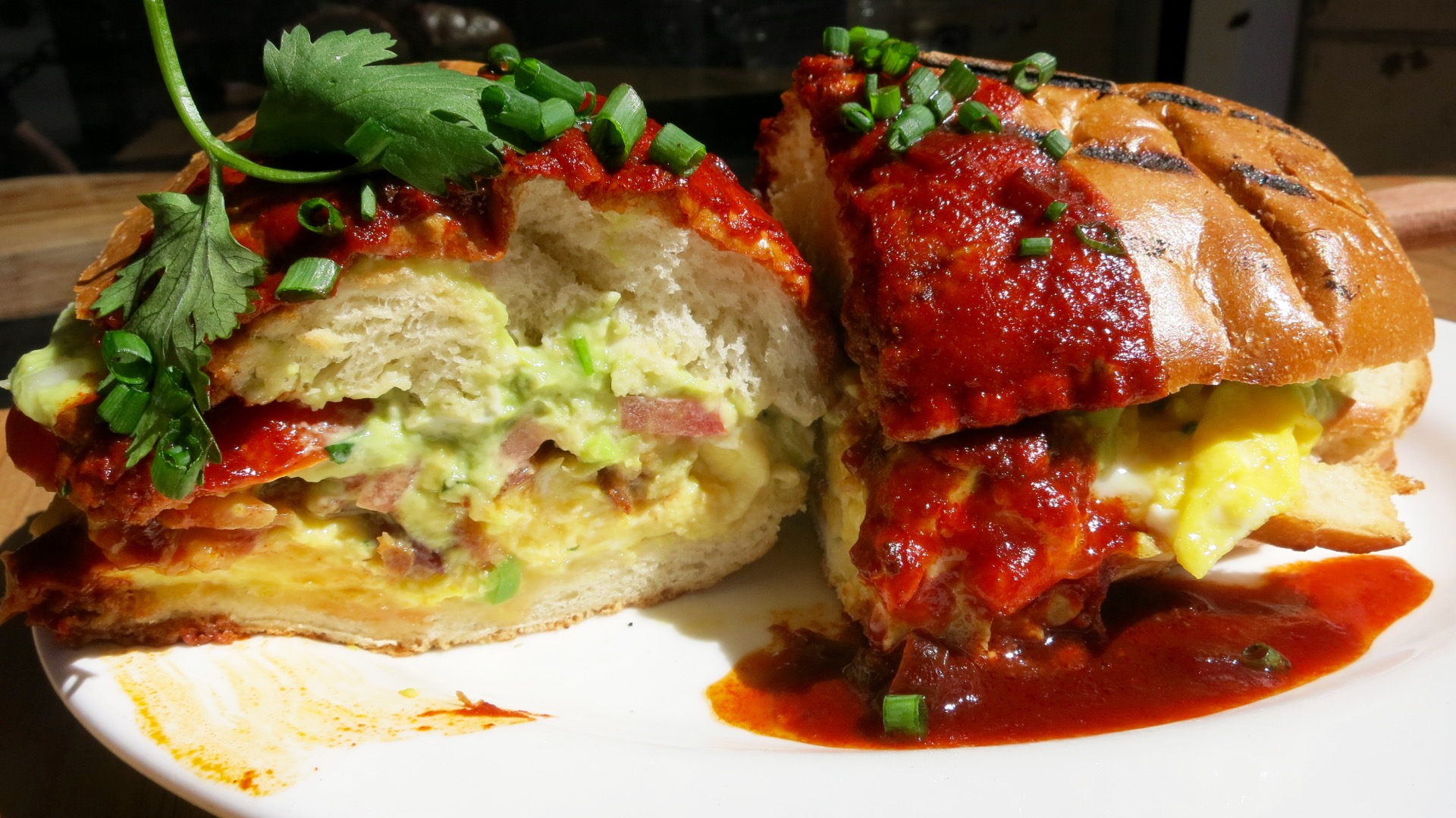 Cosecha's hefty torta sandwich requires two hands and several napkins.