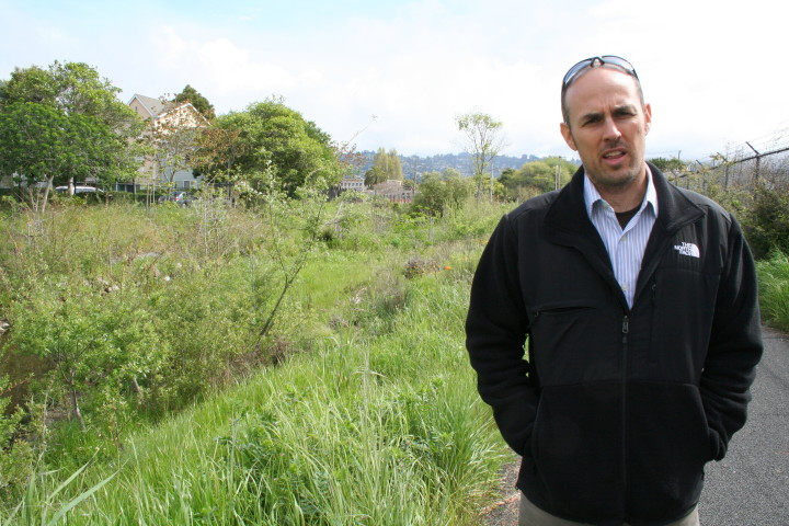 Adam Berman, in 2013, stands on the boundary of the property Urban Adamah purchased on Sixth Street. Cordonices Creek is behind him.