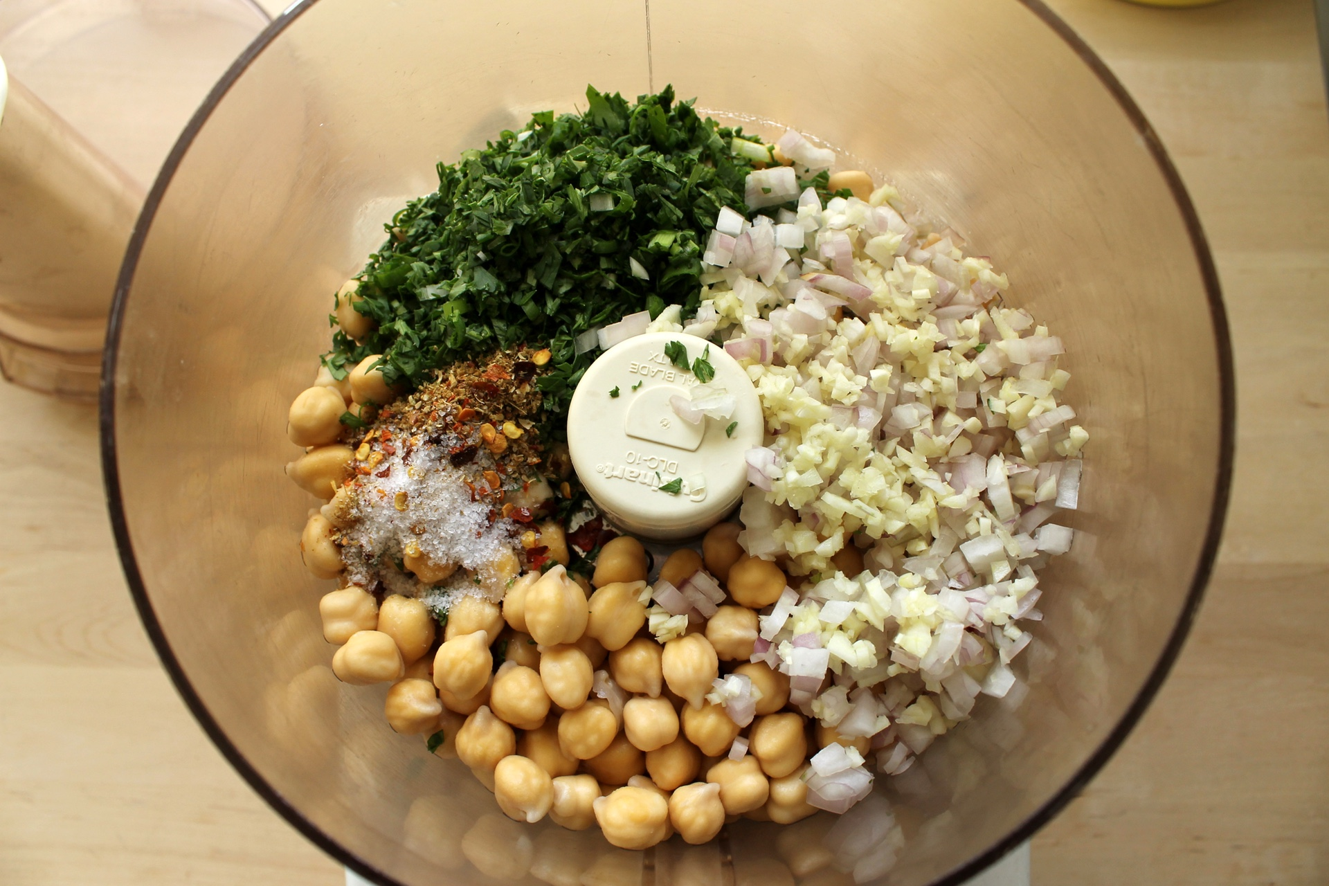 Combine the chickpeas with spices and minced aromatics.