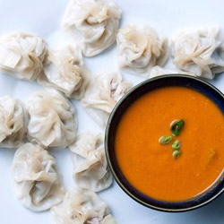 Turkey and vegetarian momo with tomato-cilantro sauce