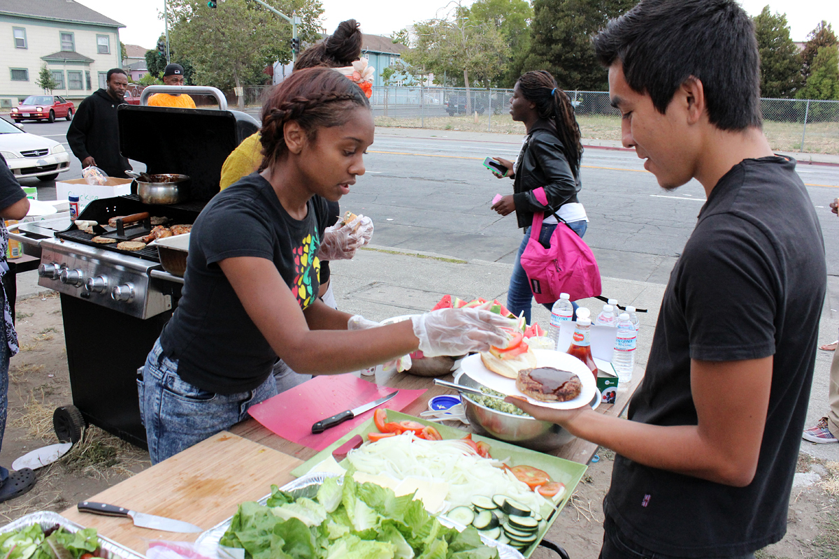 Youth volunteers with the HOPE Collaborative lead a taste test at a West Oakland corner store in the Healthy Corner Store Project.