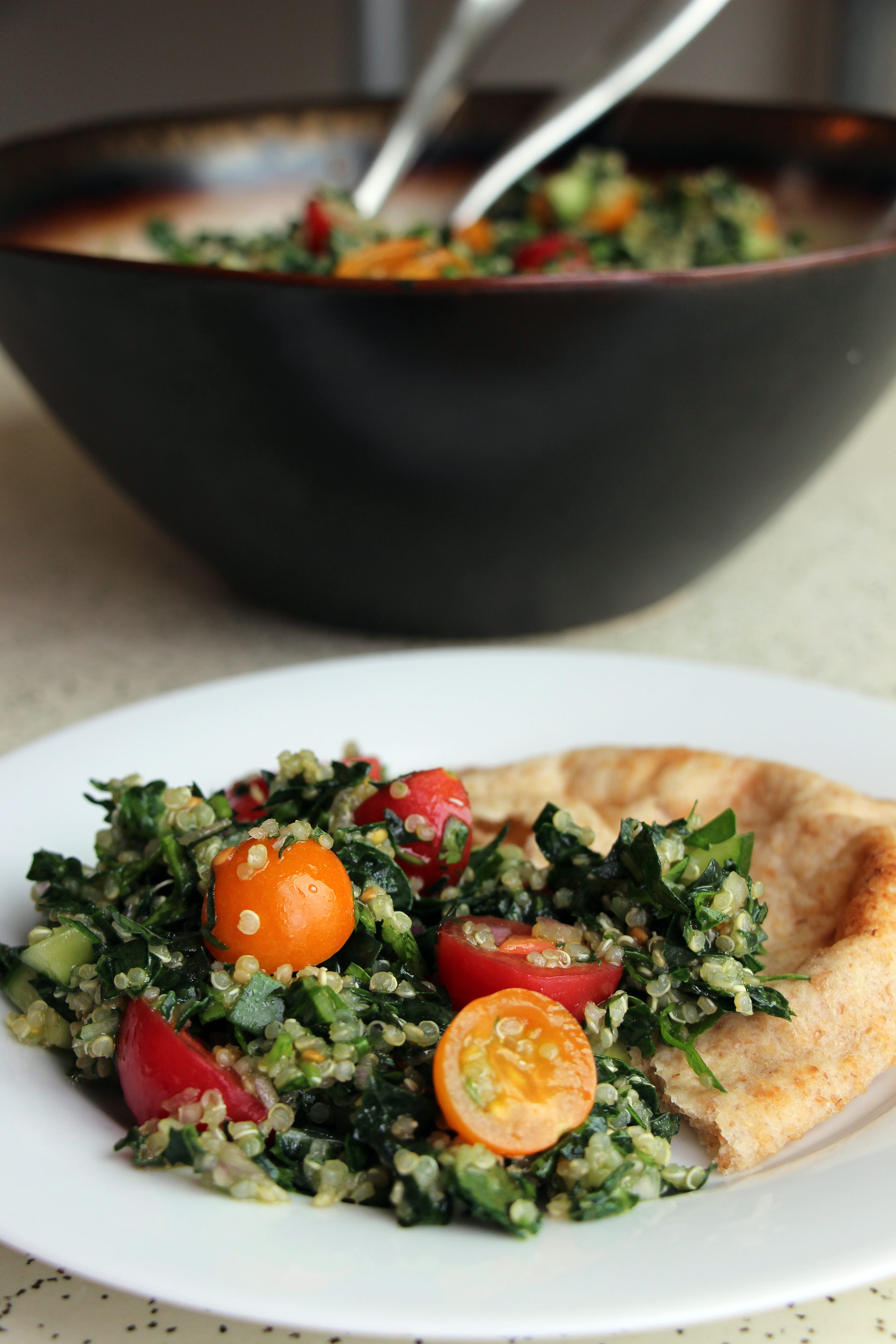 Mediterranean-Style Kale and Quinoa Tabouli with Cherry Tomatoes and Lemon with Pita Bread