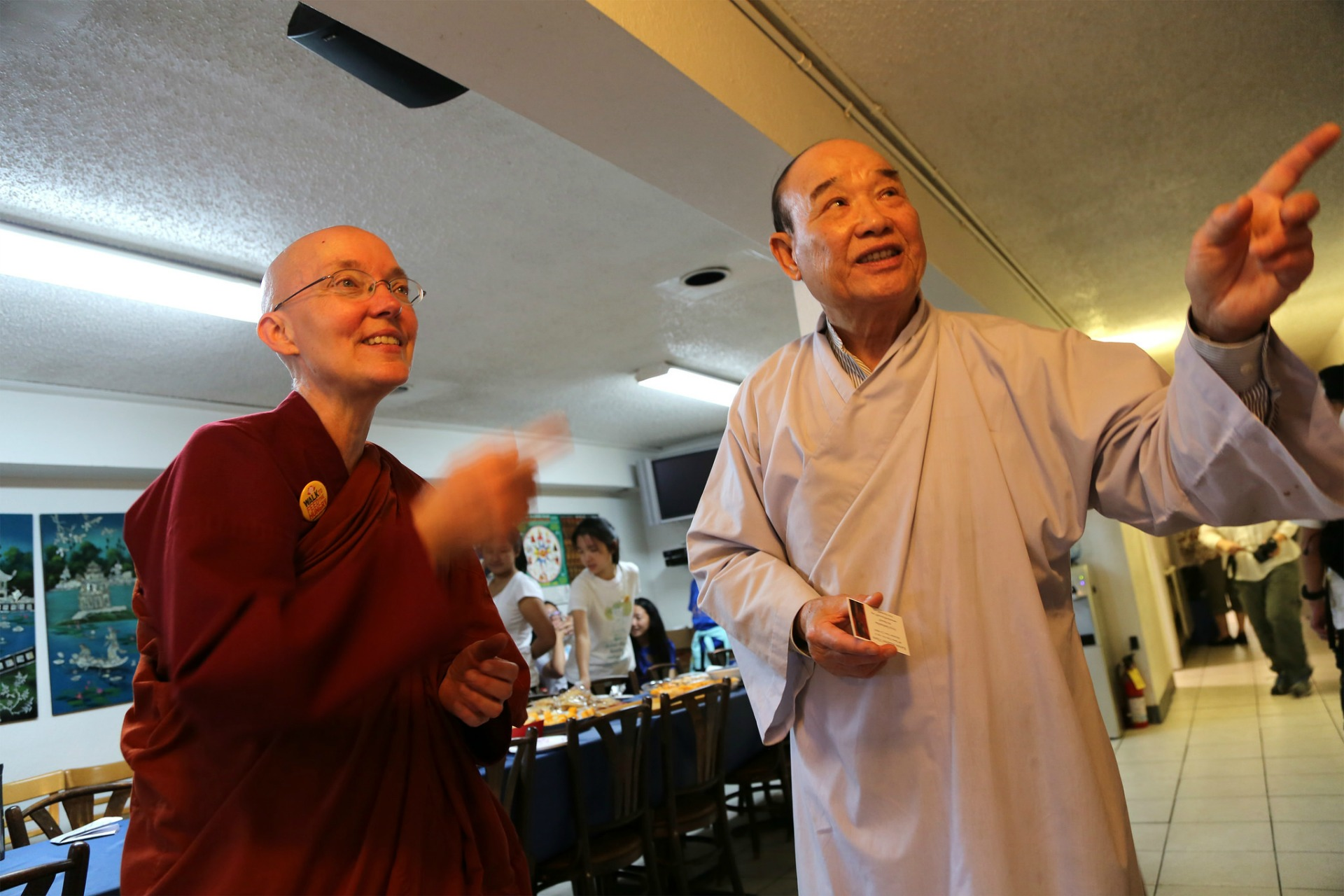 At Từ Quang Temple, walk leader Ayya Santussika Bhikkhuni talks to one of the original temple founders, Minh Huynh