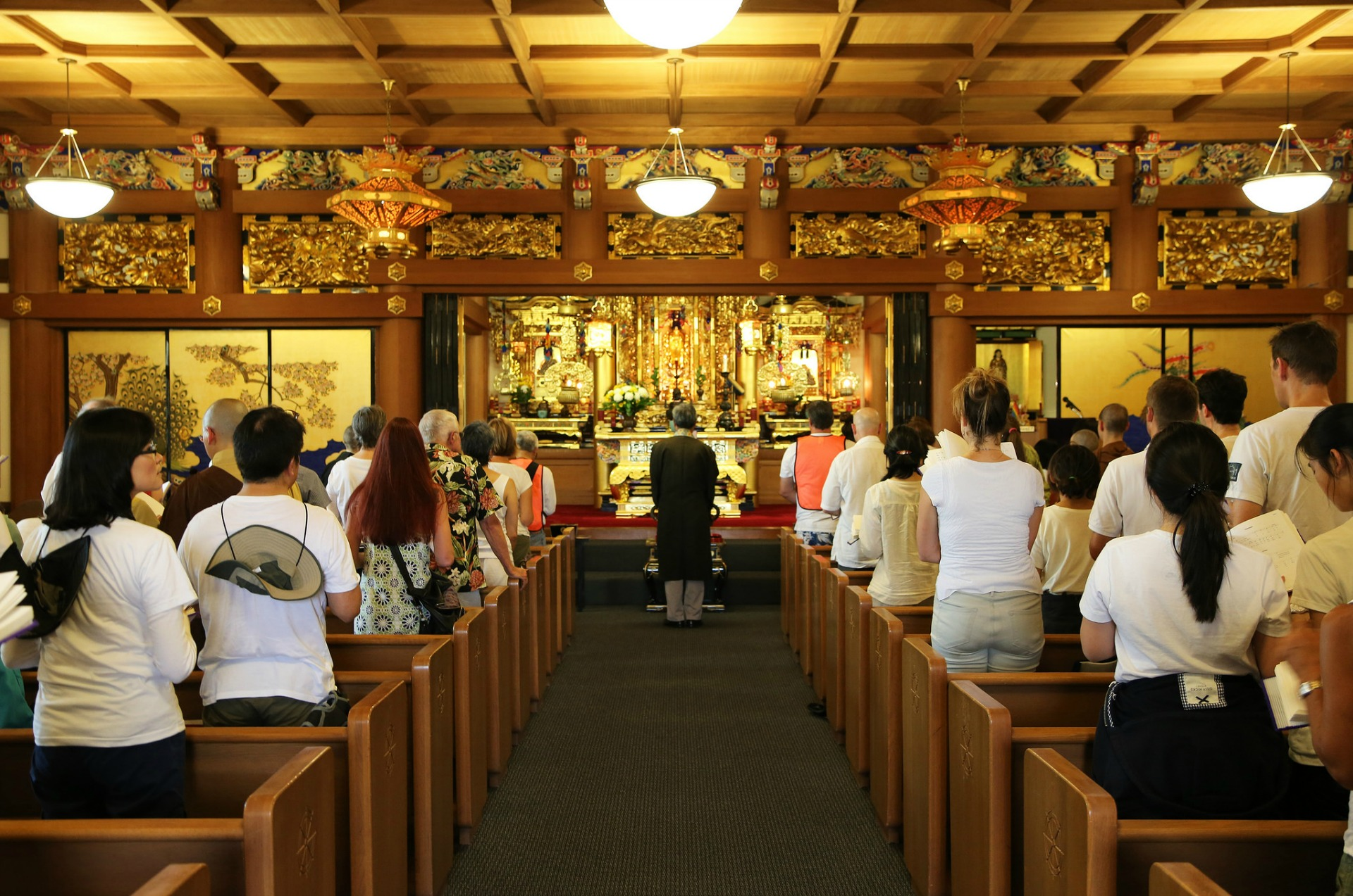 Last year's group at the Buddhist Church of San Francisco, where Rev. Ronald K. Kobata is leading them in devotional chanting