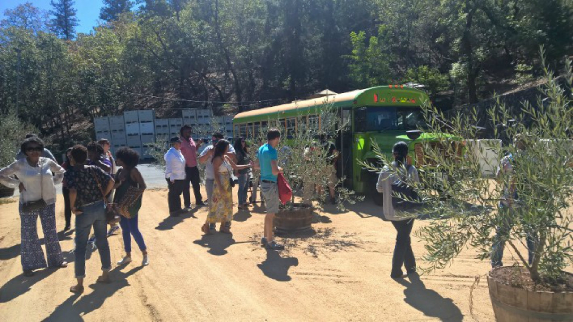 "Attendees board the ""Wine Soul Train"" (aka the Mexican Bus) at the Council's recent event"