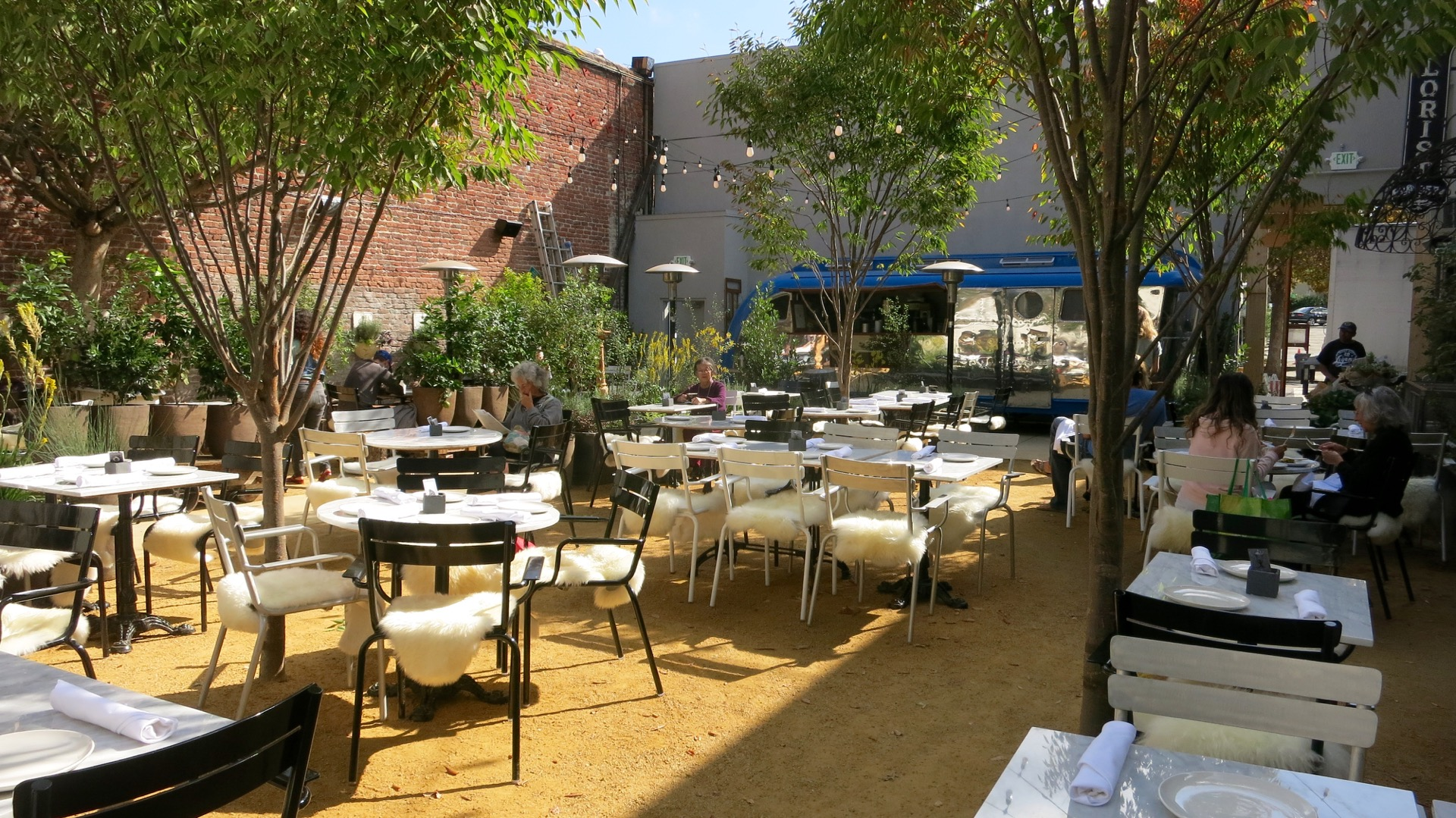 The seated outdoor dining area within the 1200-square-foot garden at Grand Fare Market.