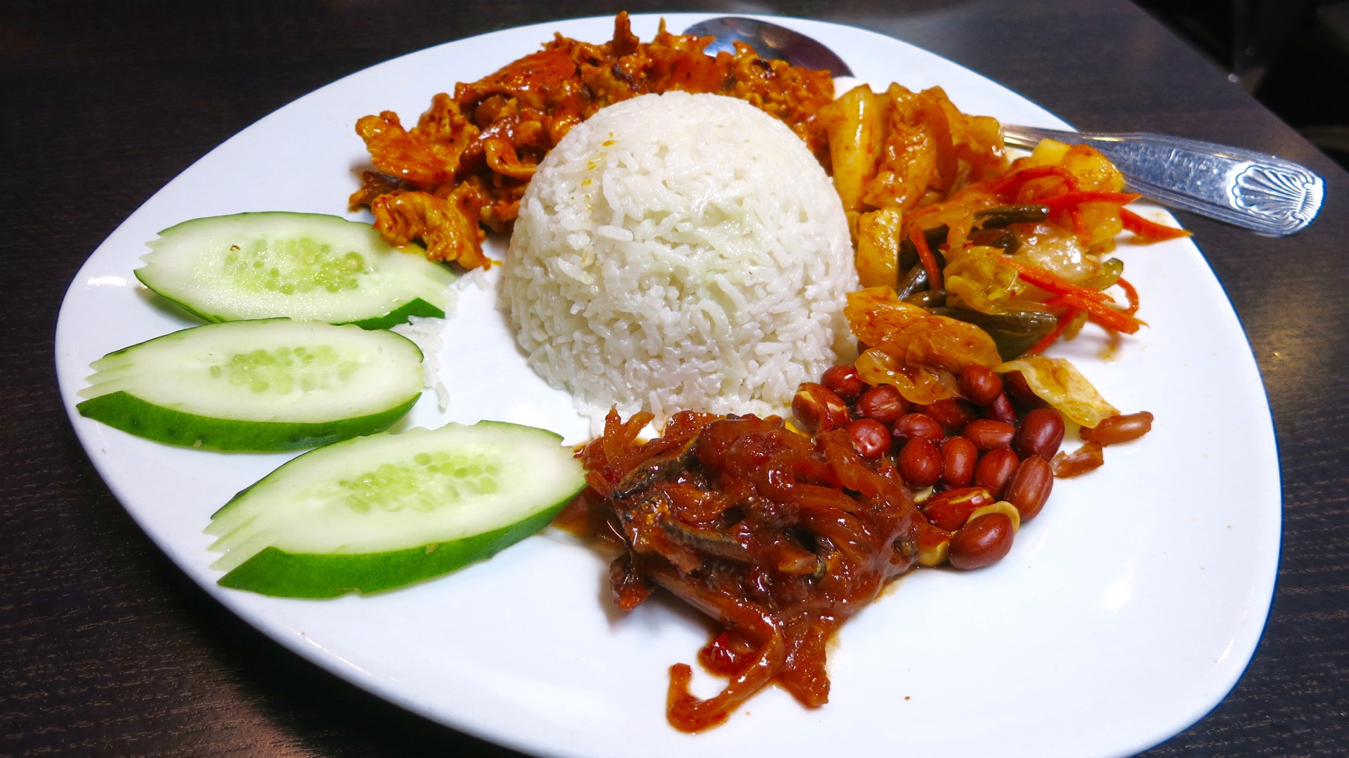 Chilli Padi's nasi lemak is a spicy melange of salty, fishy and savory flavors.