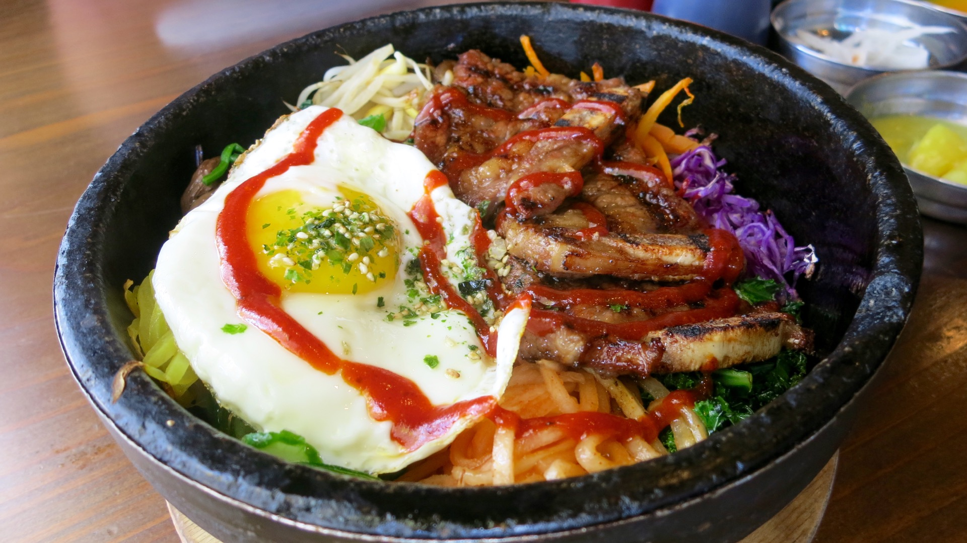 A symphony of sounds and flavors come with the sizzling dol sot bi bim bap at Bowl'd.