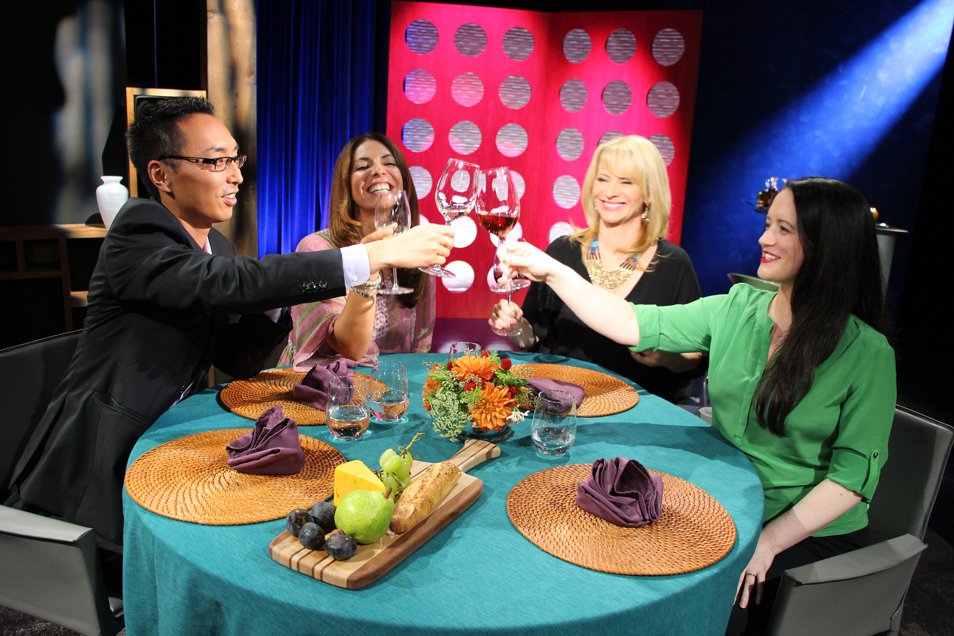 Check, Please! Bay Area host Leslie Sbrocco and guests toast on set.