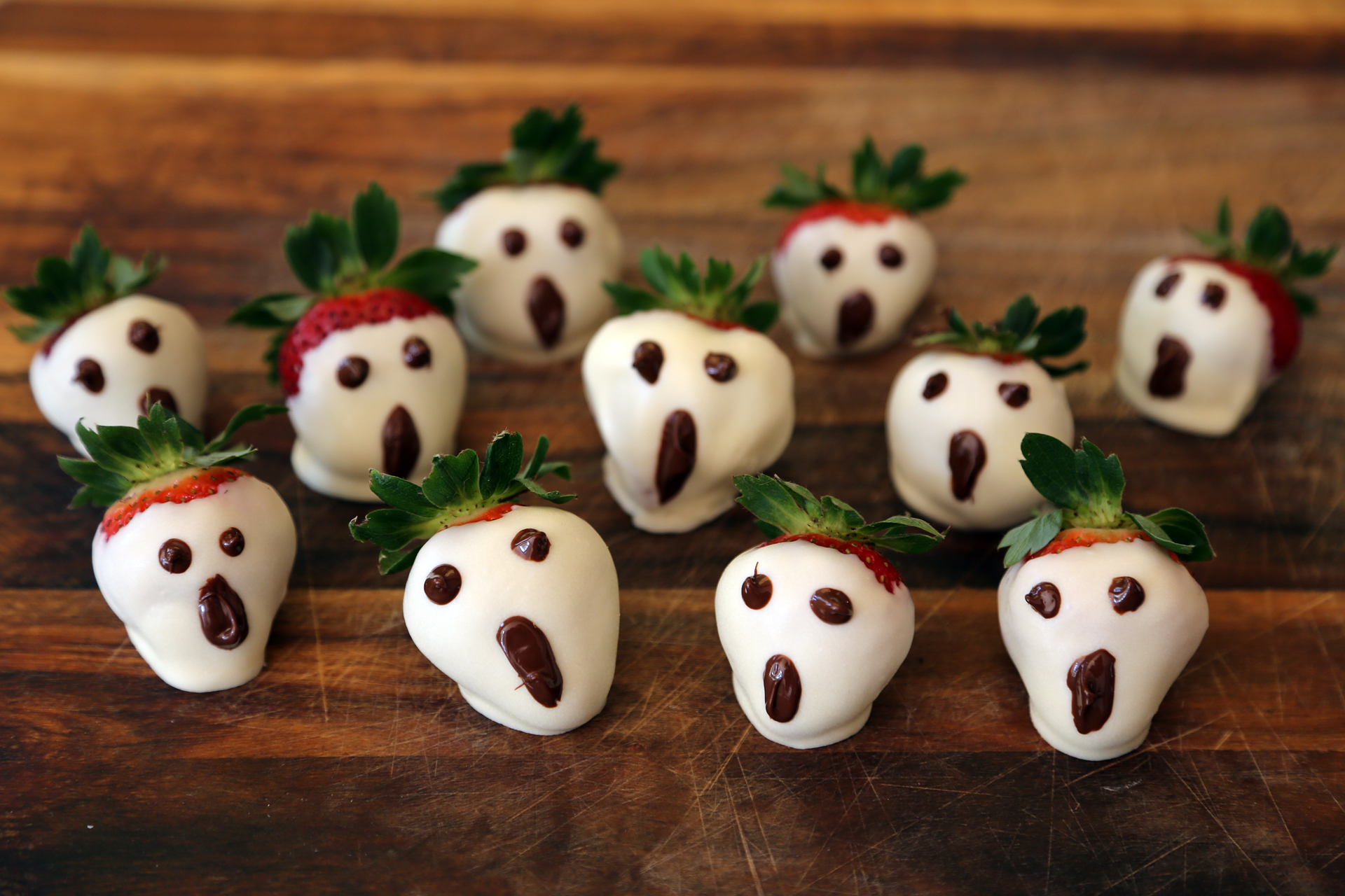 The ghoulish strawberries are ready to serve as soon as they set.